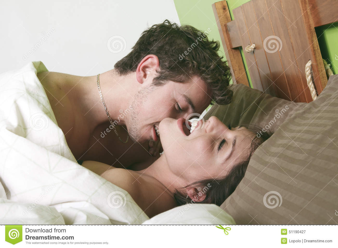 Sexy Couple Kissing On Bed