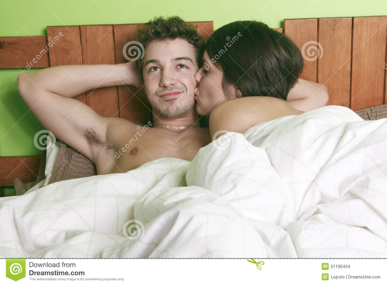 Sexy young couple kissing and playing in bed stock photo for Sexy bed photos