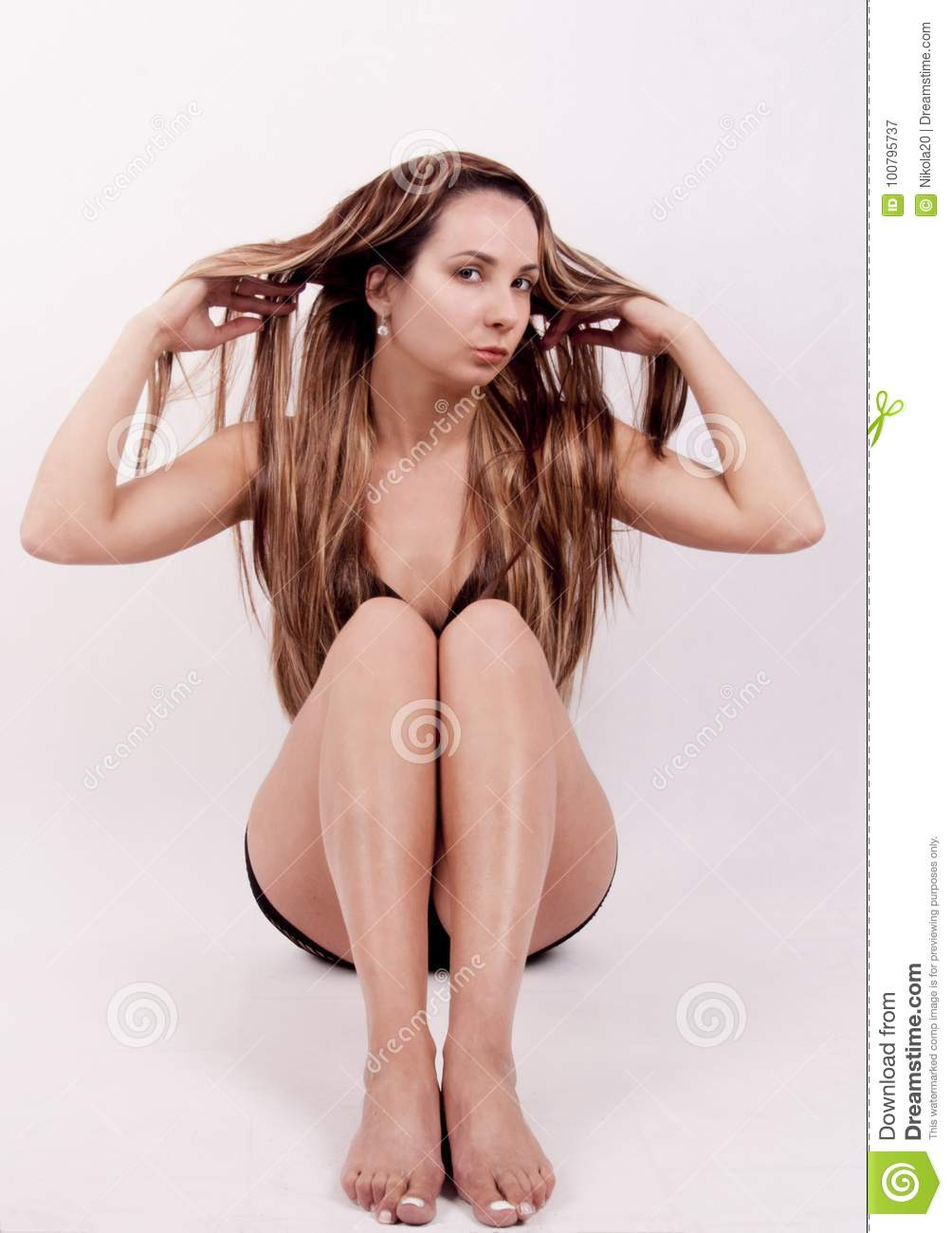 9f98f15f54d young girl in a black bathing suit on a white background. More similar stock  images