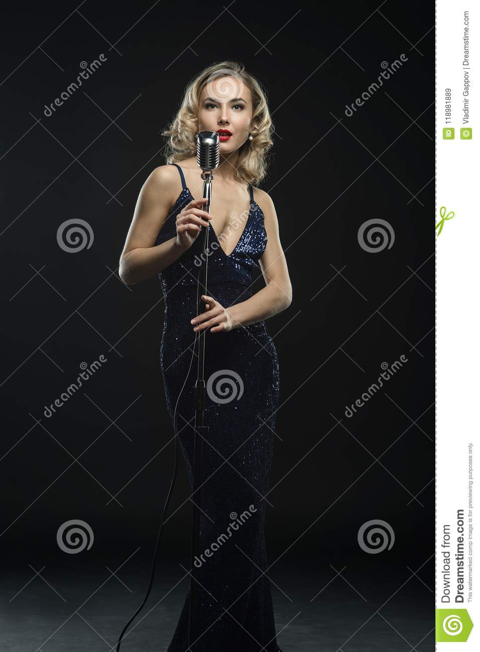 young girl singer singing with silver retro microphone