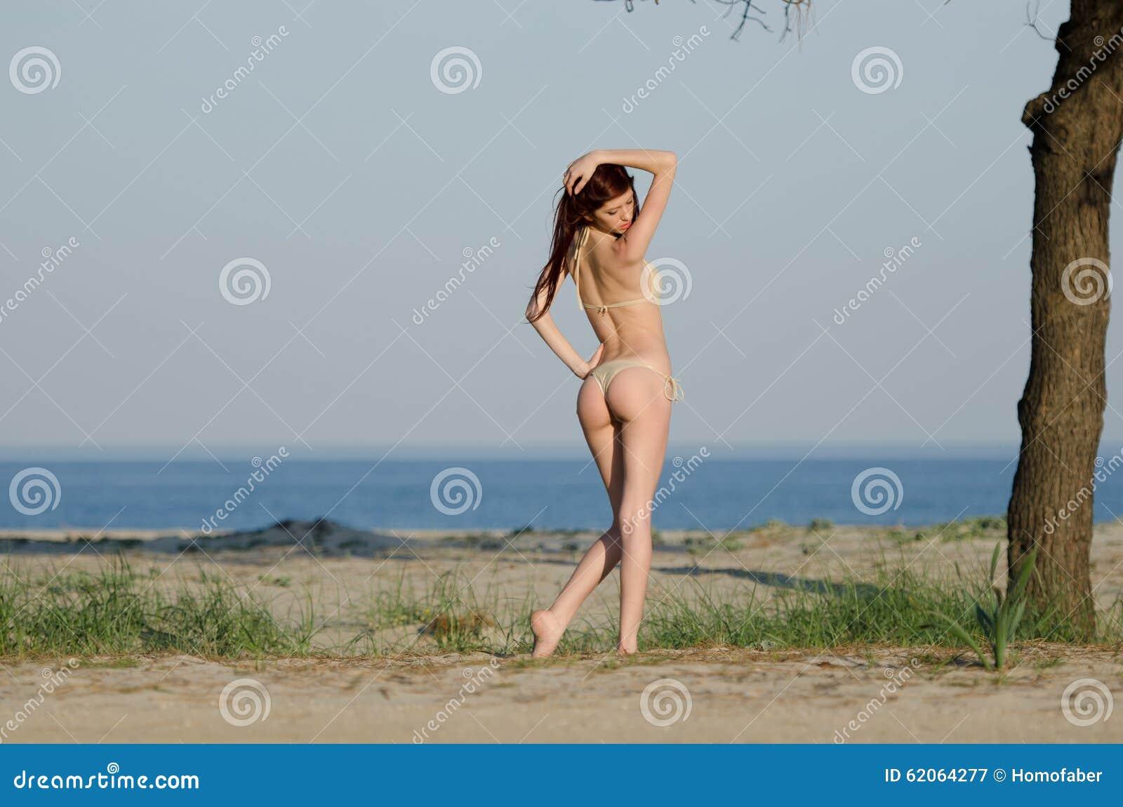 young red hair woman wearing coverall bikini