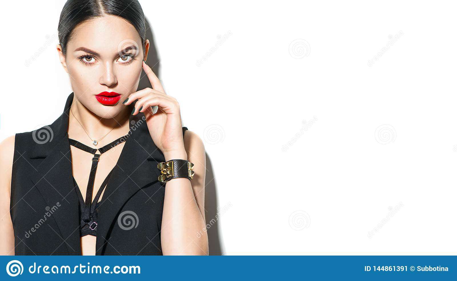 Sexy young woman portrait,  on white background. Seductive brunette model girl in black sexy clothes, fashion accessories