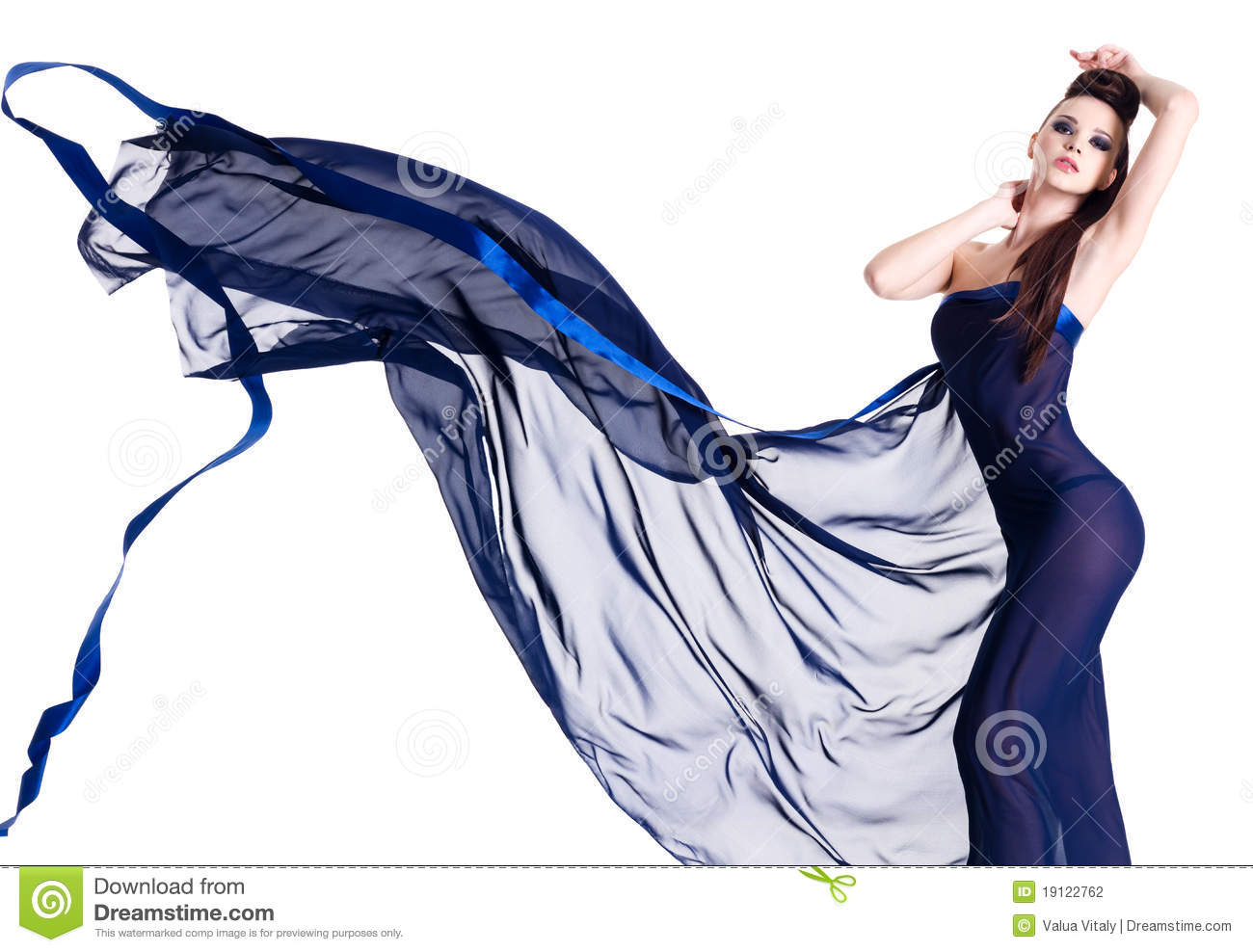 young woman posing in blue chiffon