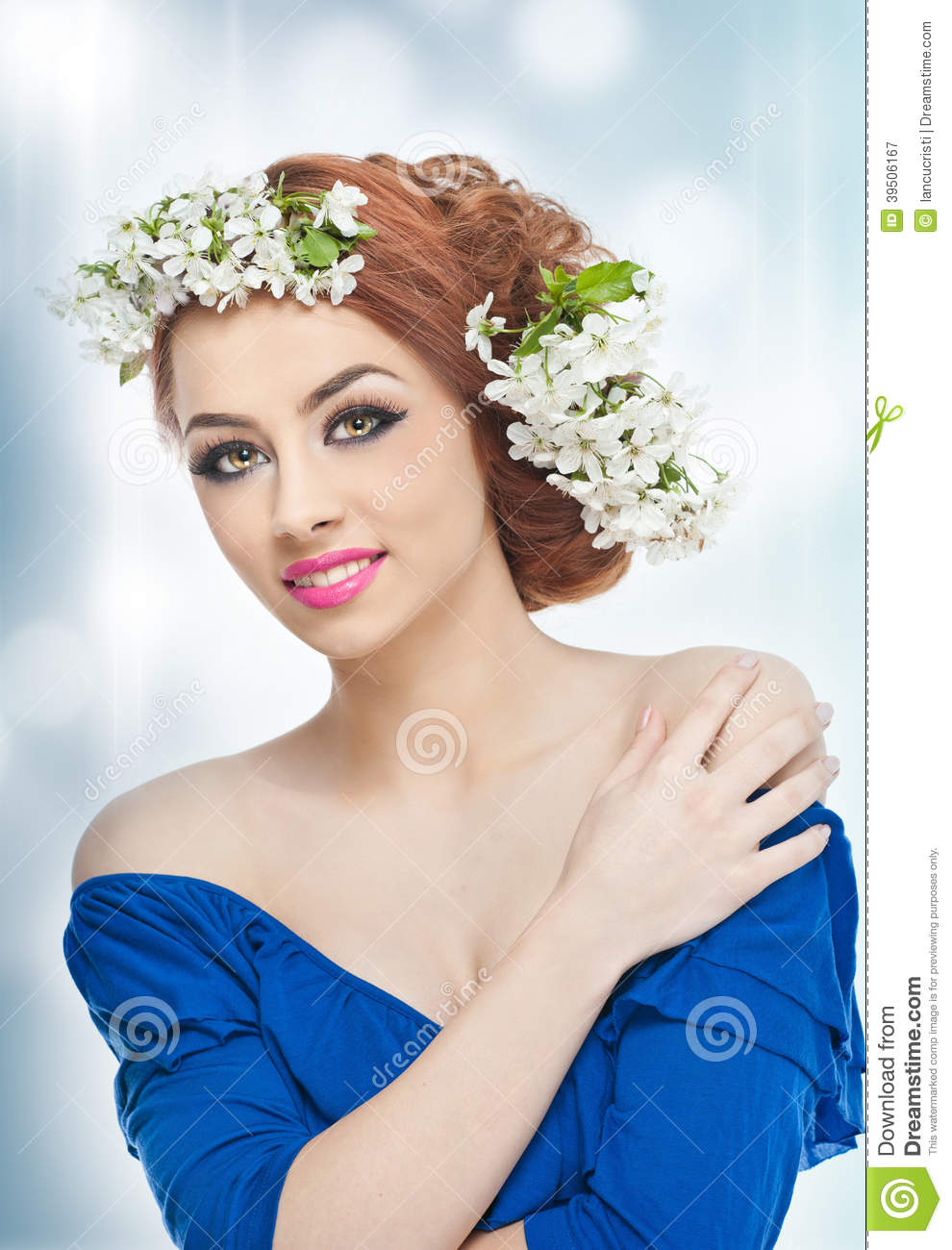 young woman with spring white flowers