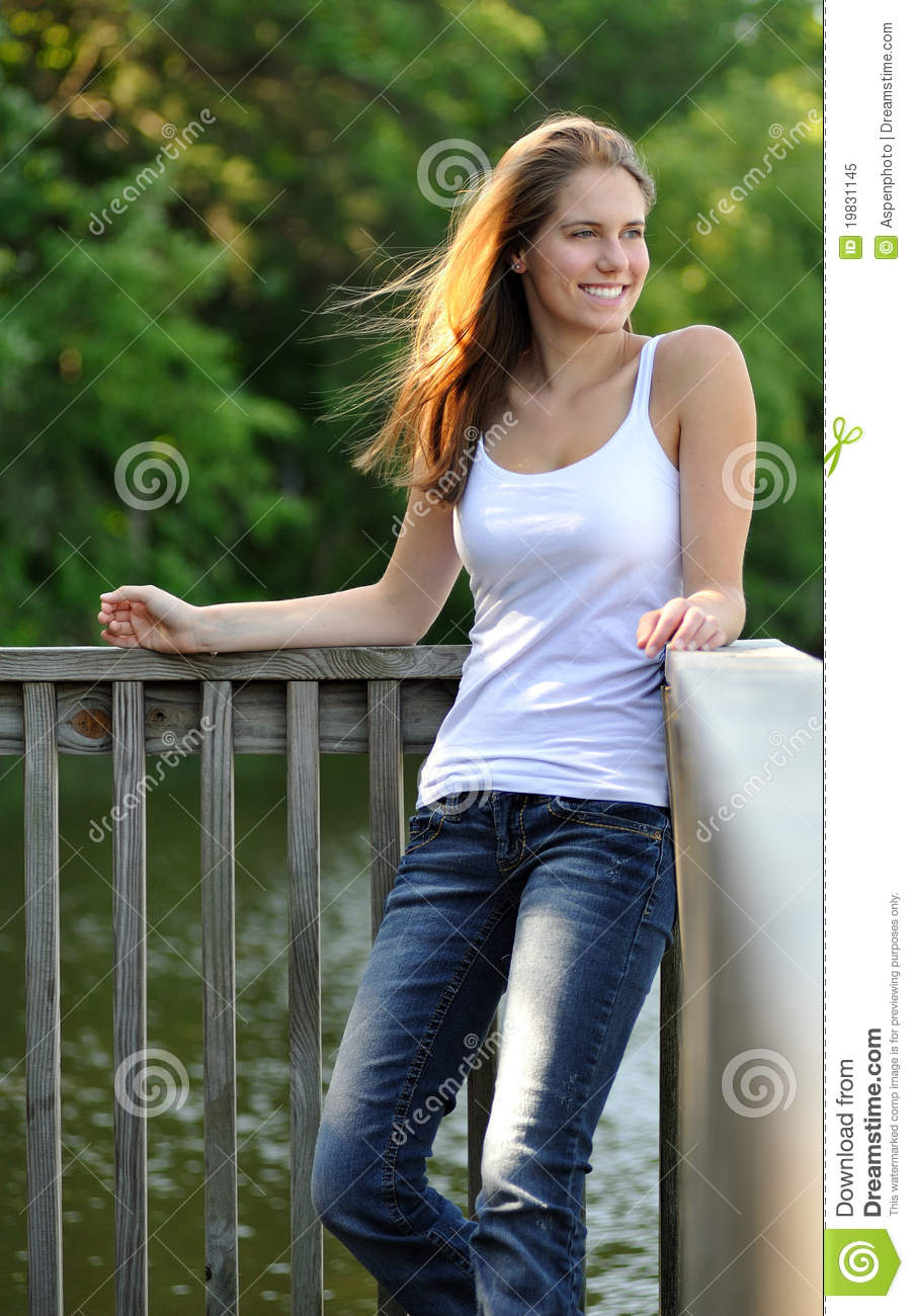 Sexy Young Woman Standing Against Railing Royalty Free