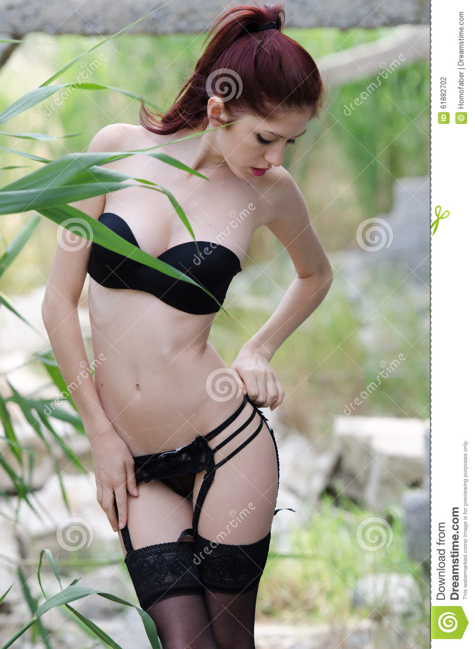 fa5f8484230 Young Woman Wearing Lingerie In Wild Landscape Stock Photo - Image ...