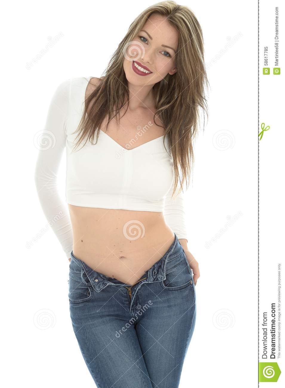 Young Woman Wearing A White Vest Top And Blue Jeans Stock Image ... 39a3a1061e7
