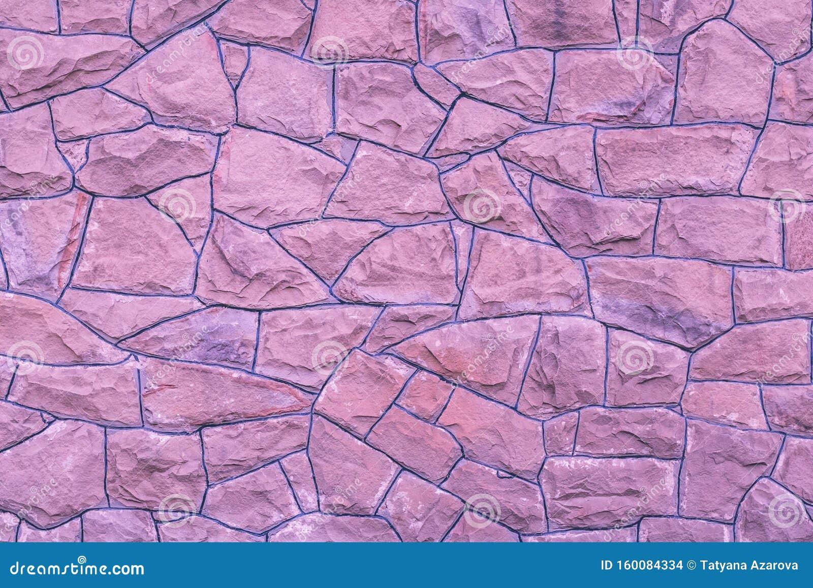 Sfondo di parete in pietra viola Tessitura rosa chiara di rocce Crittografia naturale in mattoni Sfondi di architettura astratti