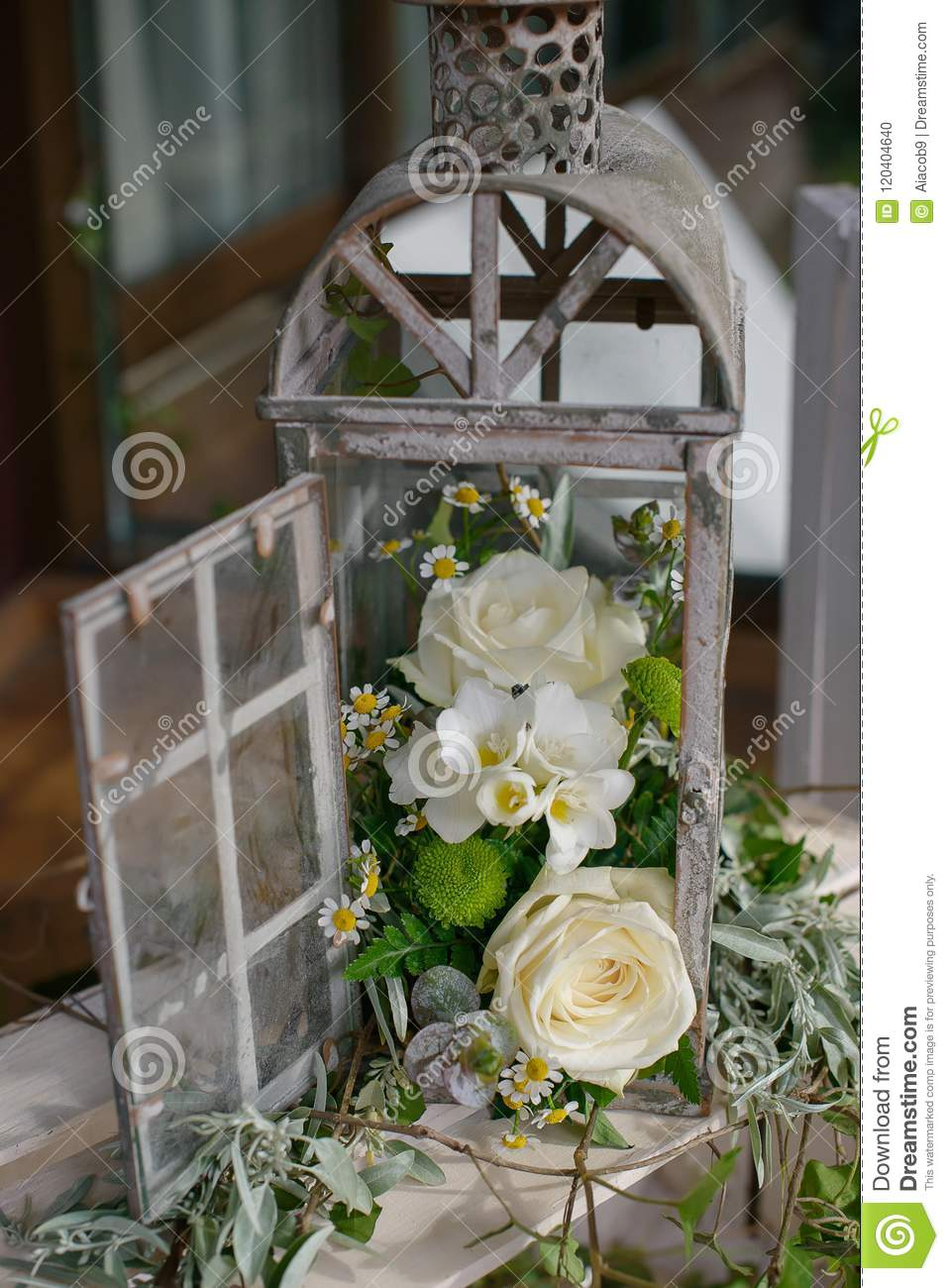 Shabby Chic Wedding Decor With Repurposed Lantern Cage Stock Photo