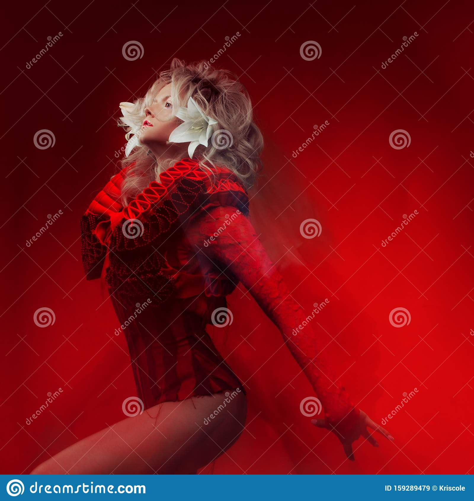 Shades Of Red Portrait Of Bizar Attractive Woman With Fashion Make Up In Fantasy Outfit Posing On A Red Background Stock Image Image Of Floral Cloth 159289479