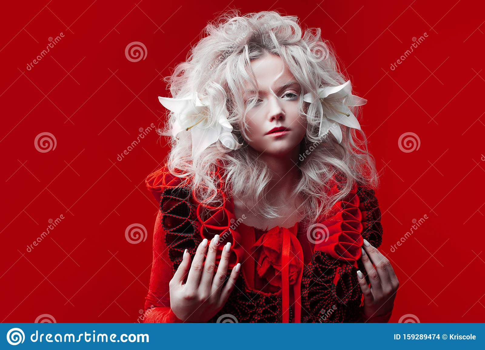Shades Of Red Strange Attractive Woman In A Red Outfit On A Red Background With Lily Flowers In Her Hair Stock Photo Image Of Female Couture 159289474