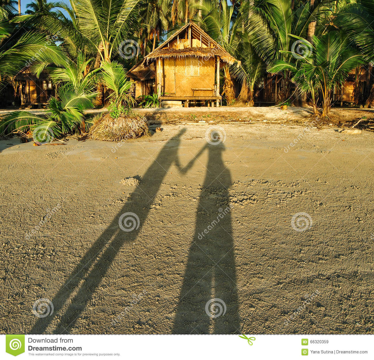 Shadow Of A Couple On The Sunset Beach Near The Bungalow