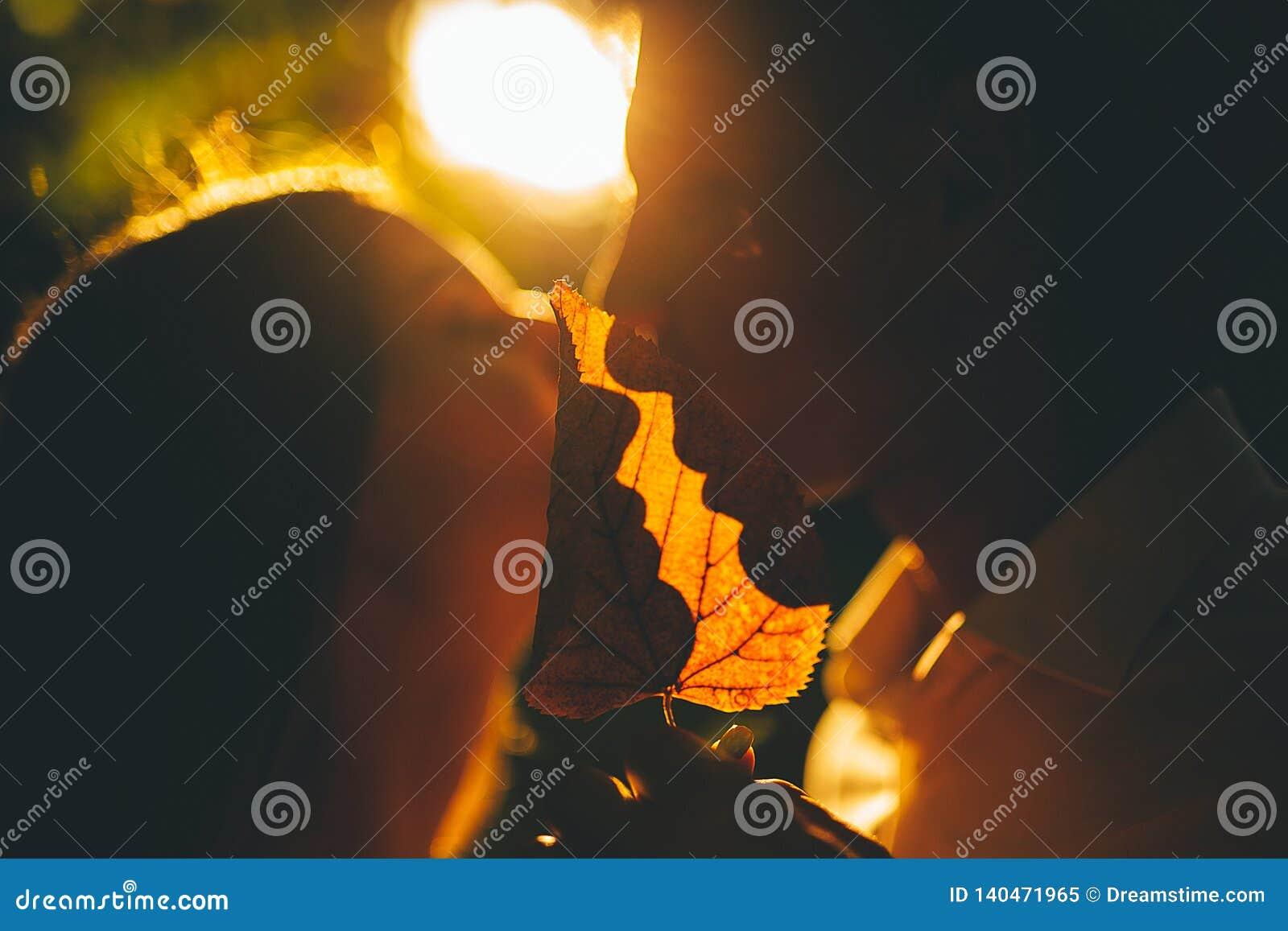Shadow of lovers lips on yellowed sheet