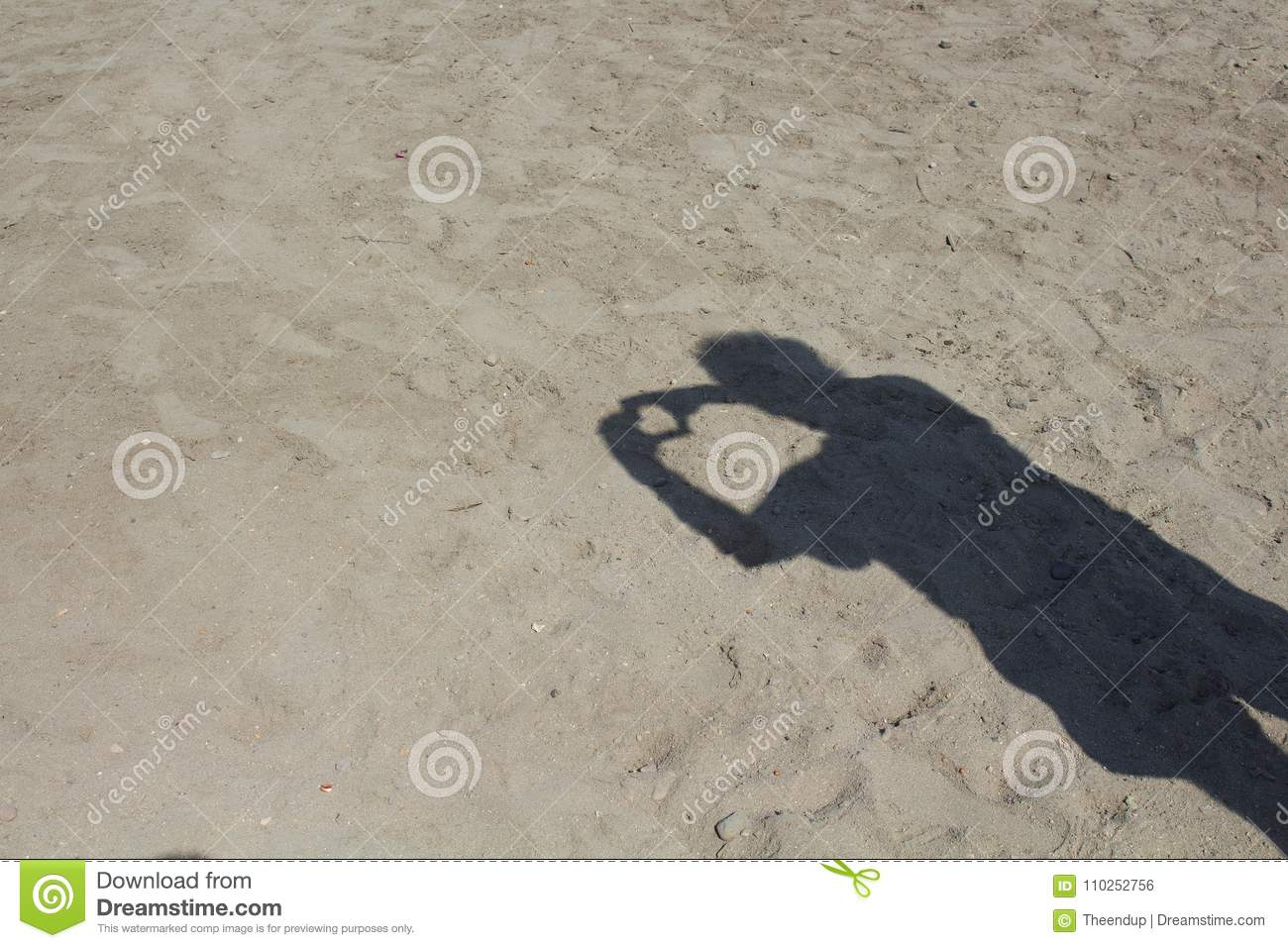 Shadow Of Man Doing Love Sign On Sand Background  Stock