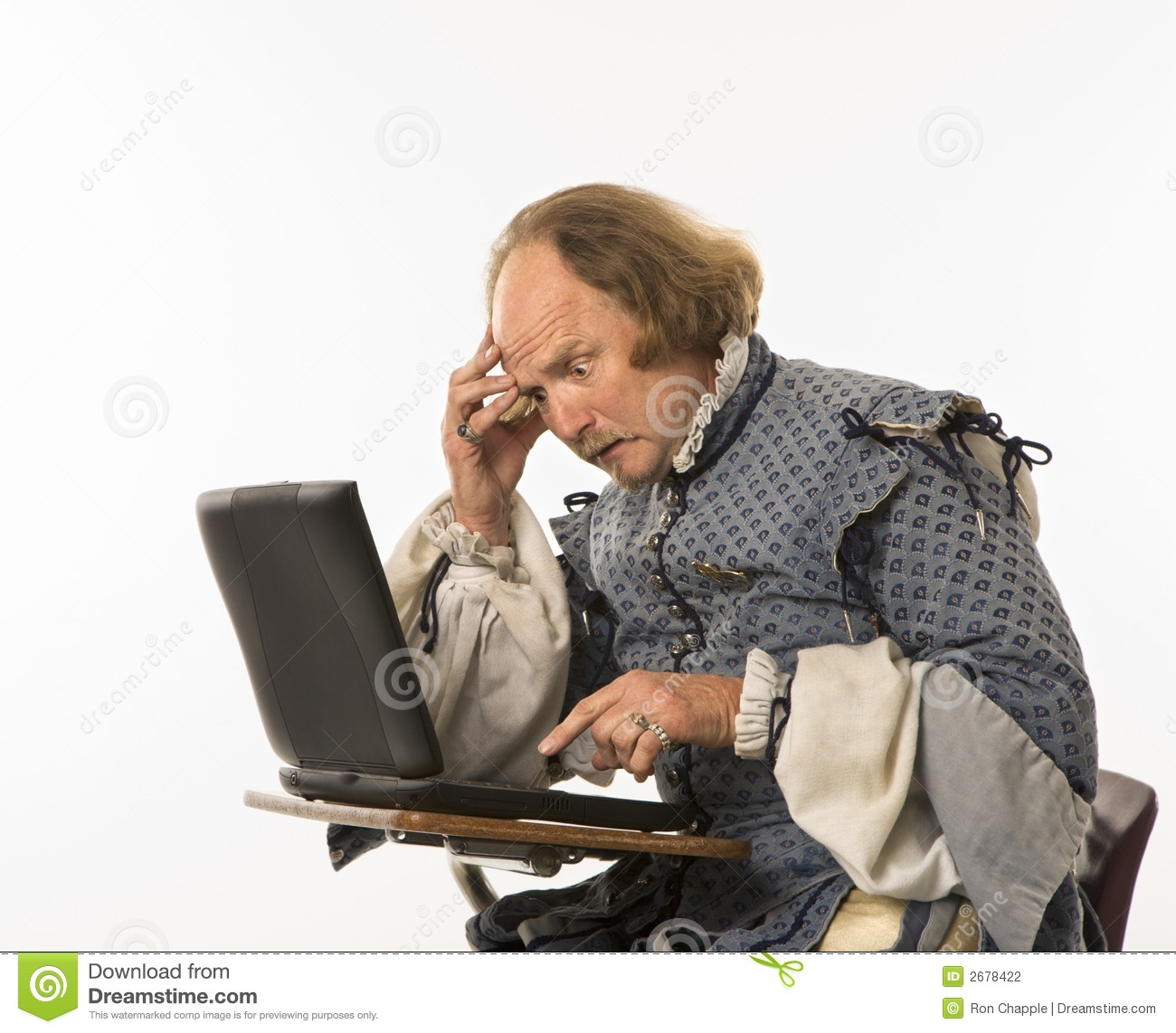 Citaten Shakespeare Pc : Shakespeare using laptop stock photography image