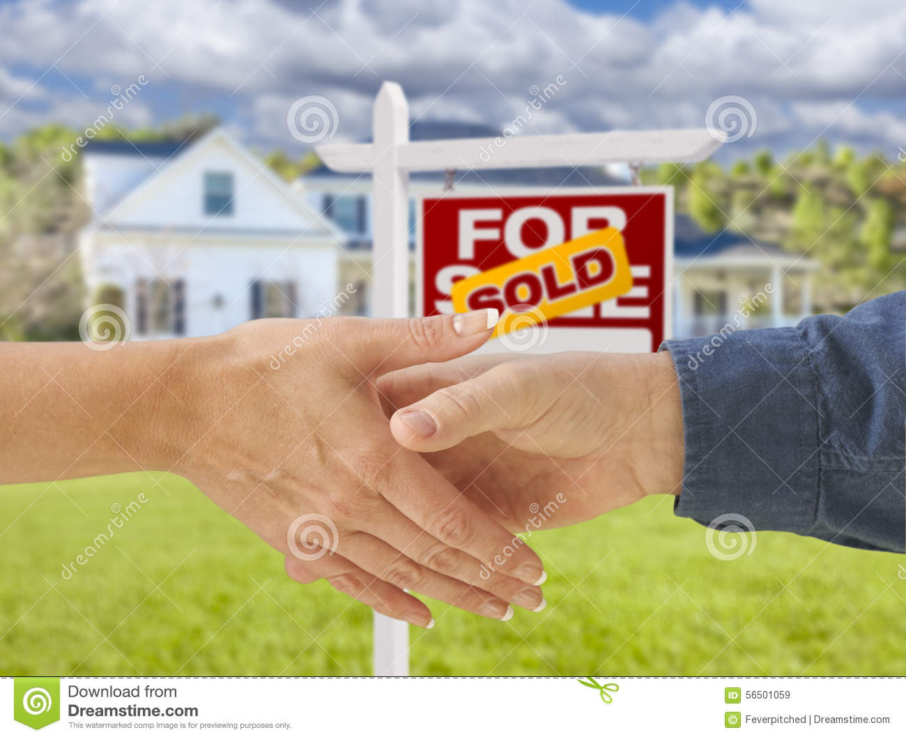 Shaking Hands In Front Of New House And Sold Sign Stock