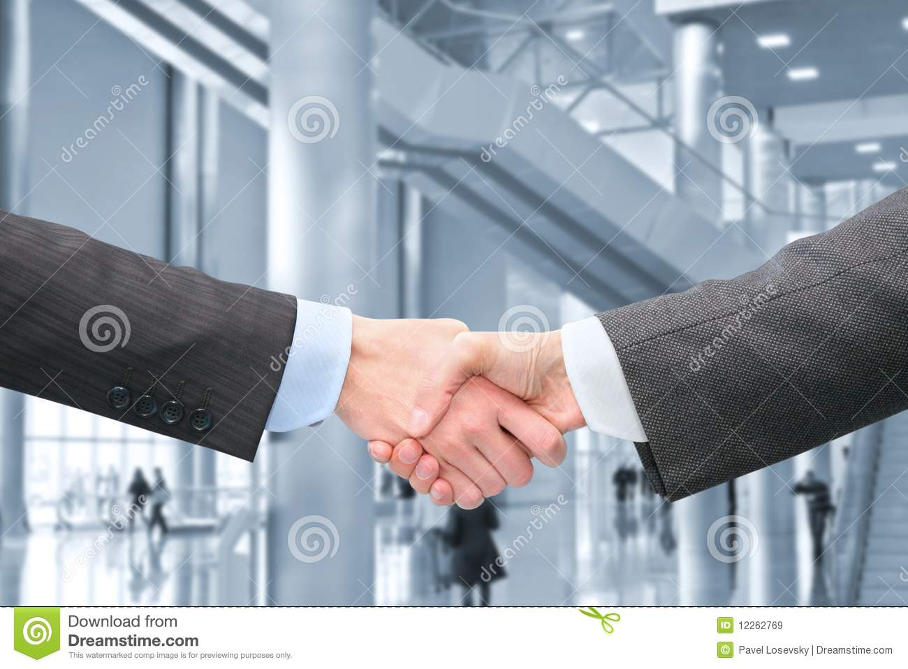 Shaking hands in hall of business center