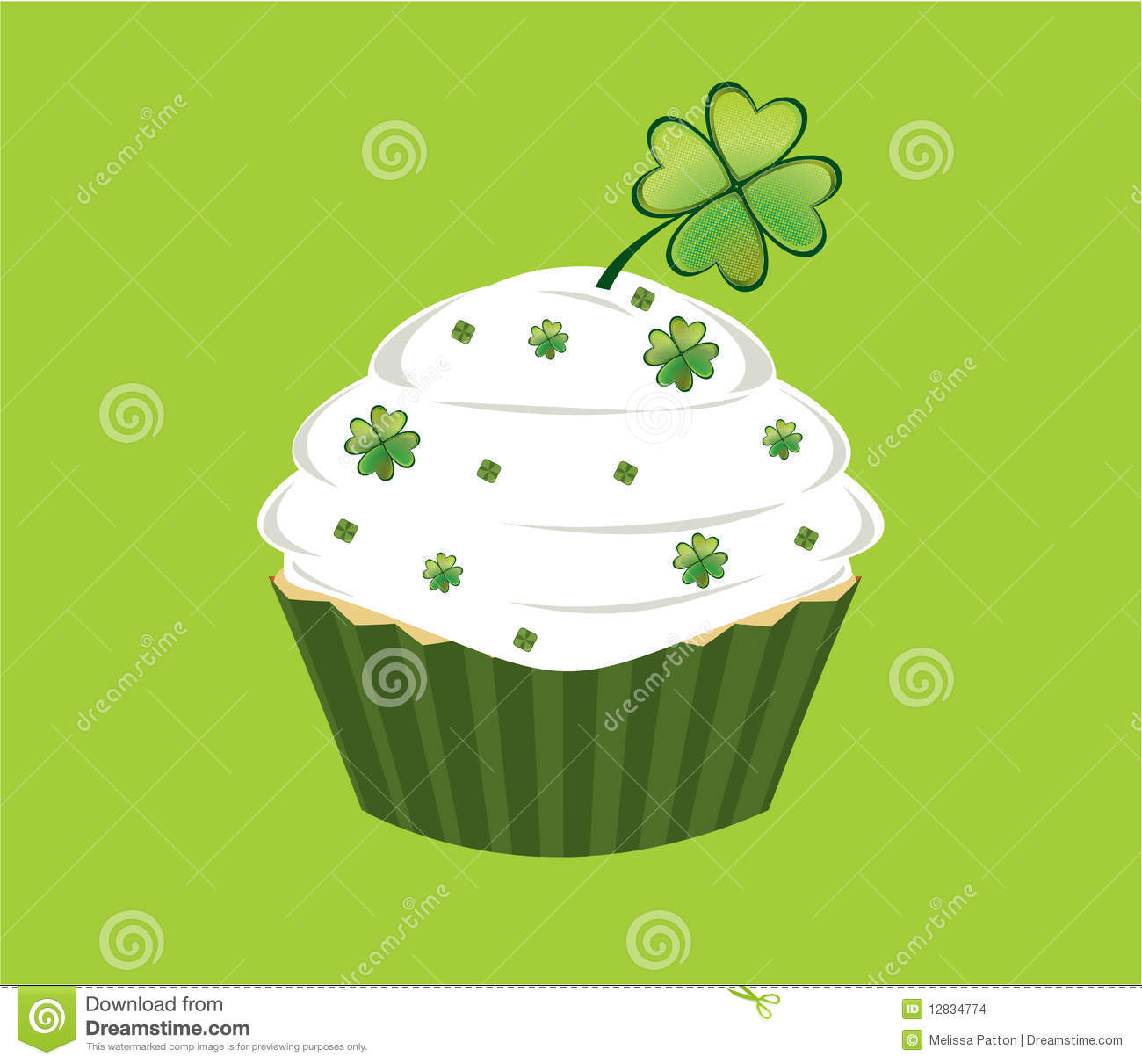 Cupcake decorated with green diamond shapes and shamrocks on white ...