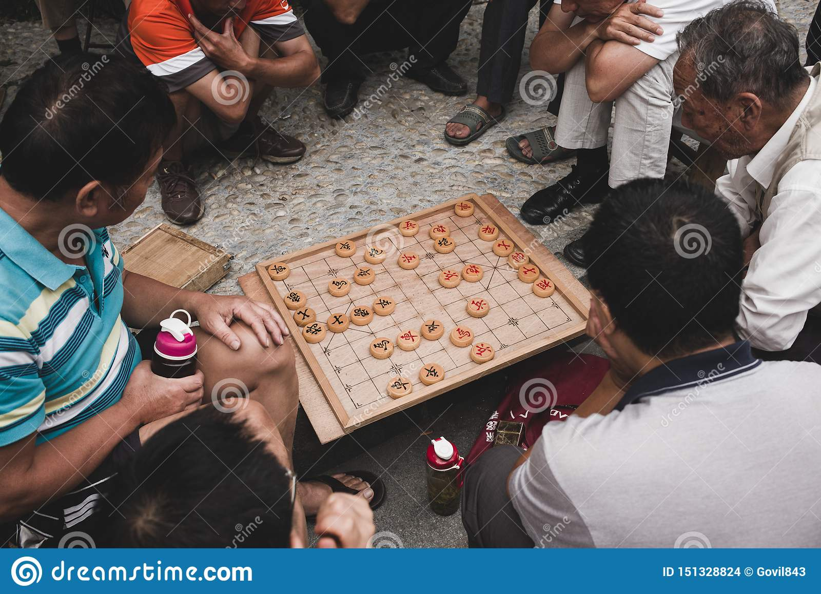 Two old man playing chinese chess xiangqi