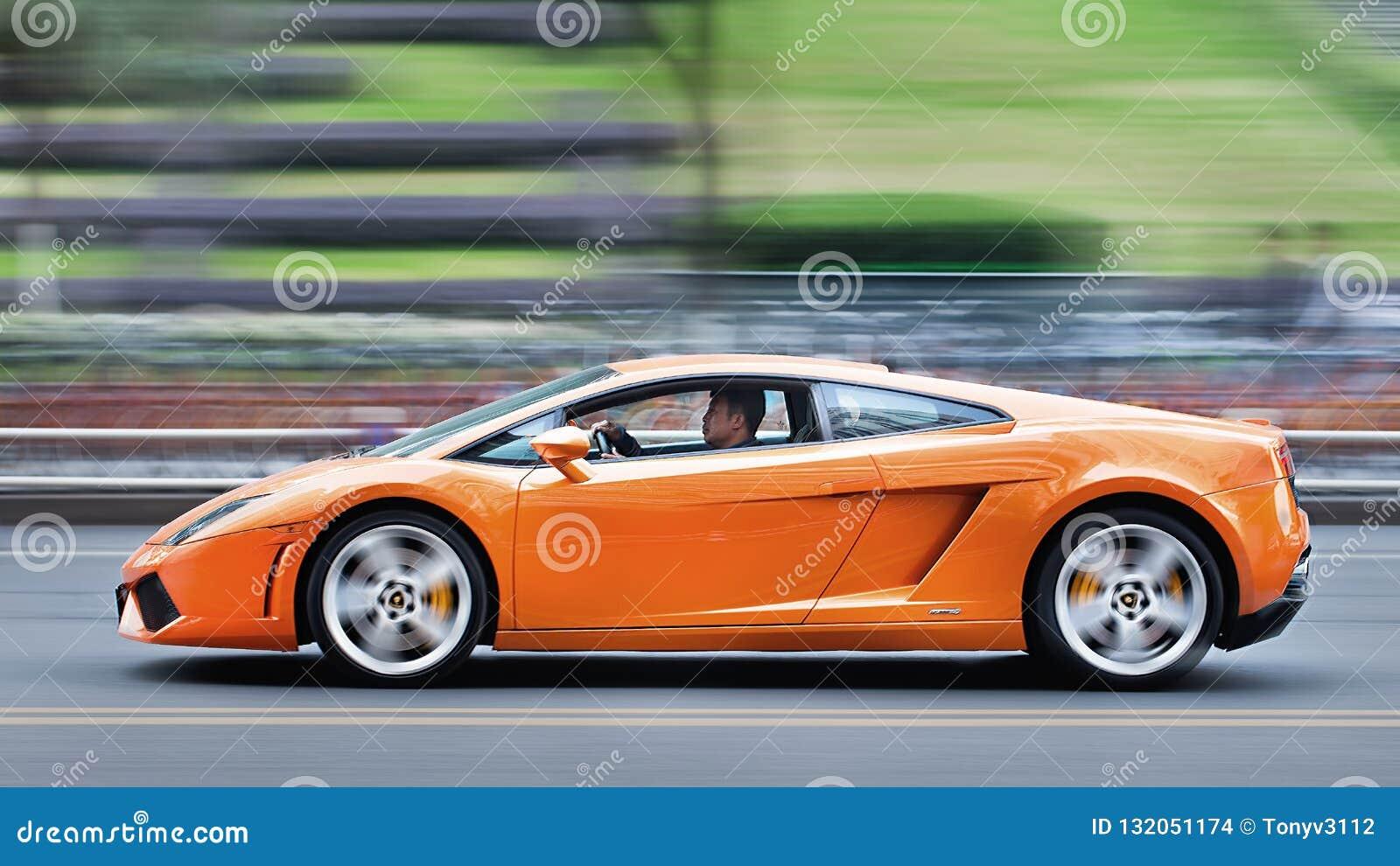 2016 Lamborghini Gallardo >> Orange Lamborghini Gallardo Riding On The Street Shanghai Editorial