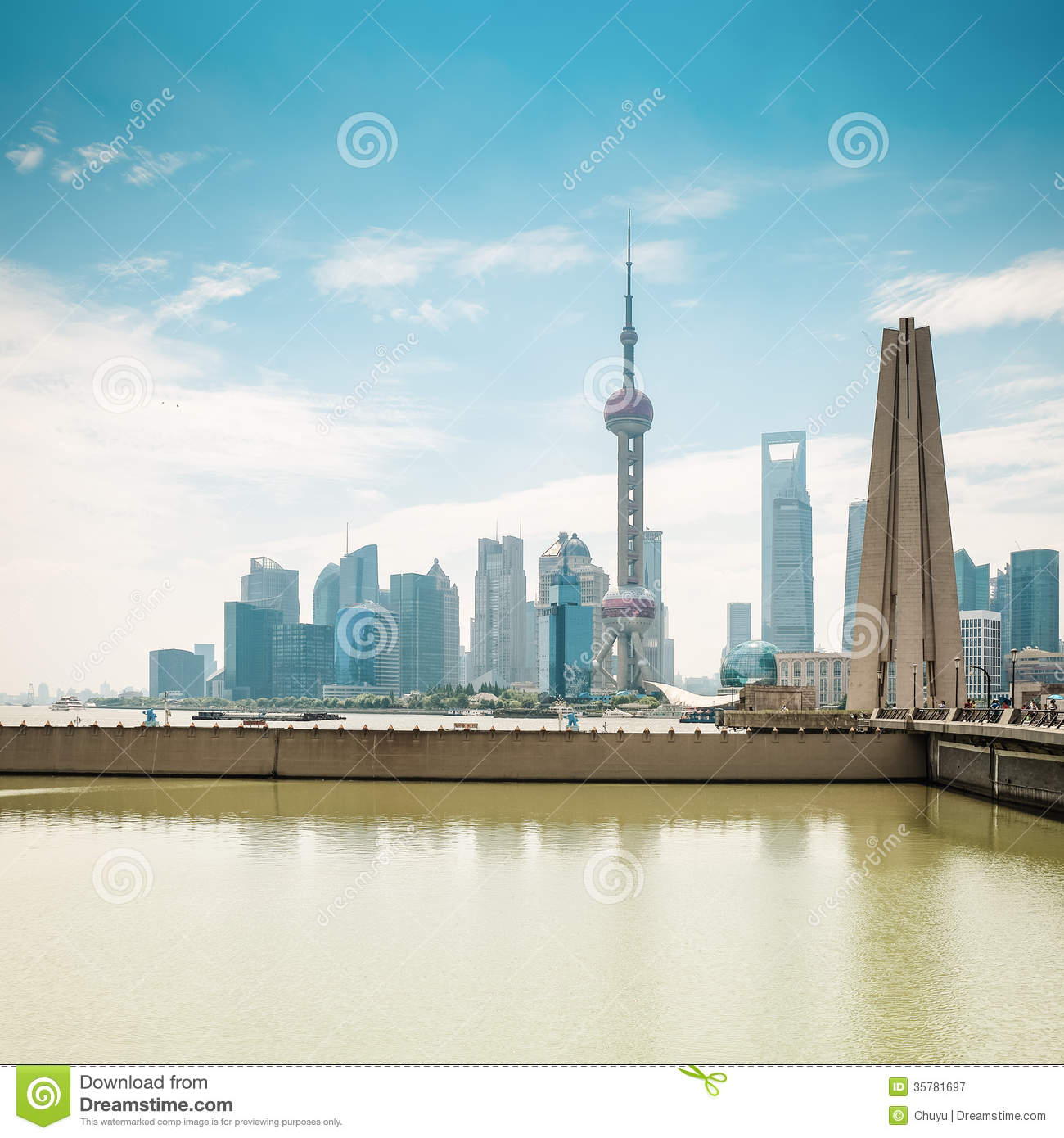 Shanghai pudong skyline in daytime with monument and suzhou river.