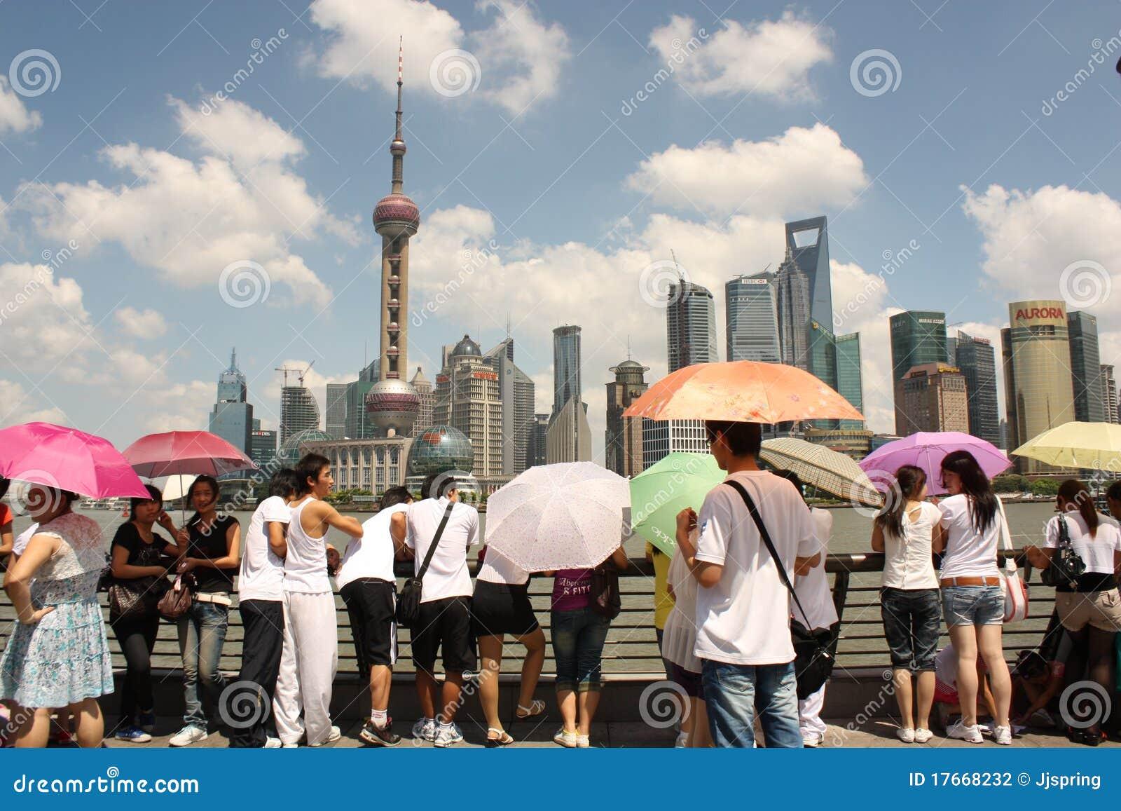 Shanghai skyline with tourists