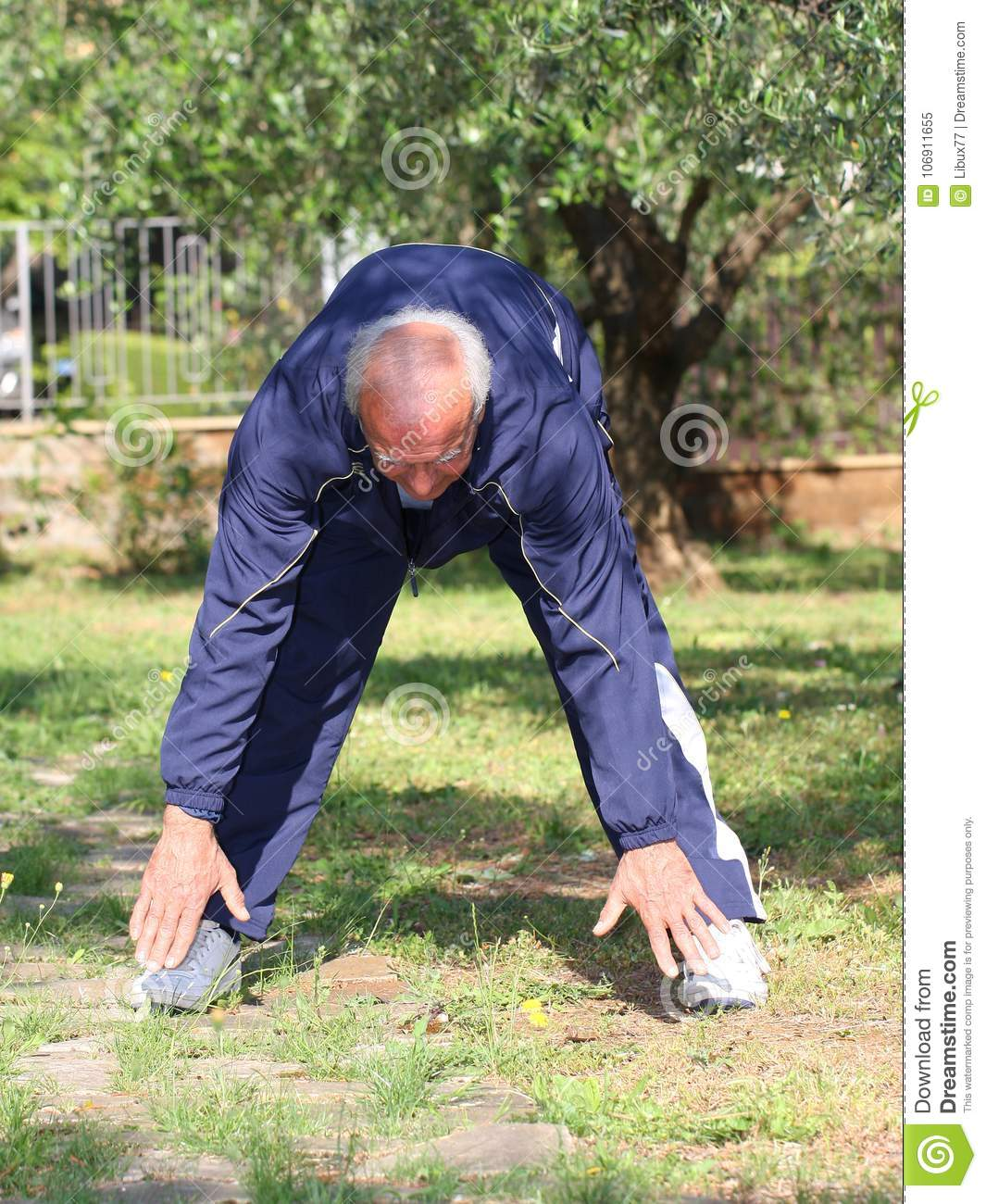 In shape old man stretching outdoor