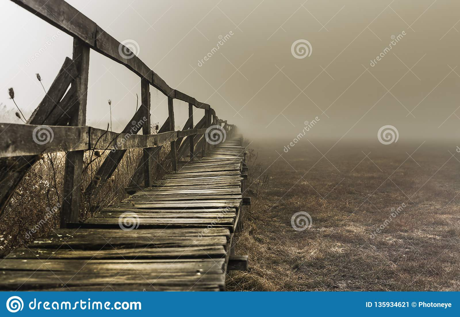 Shape of a pier near a lake, wintertime on a foggy morning, in Sic village, Transylvania
