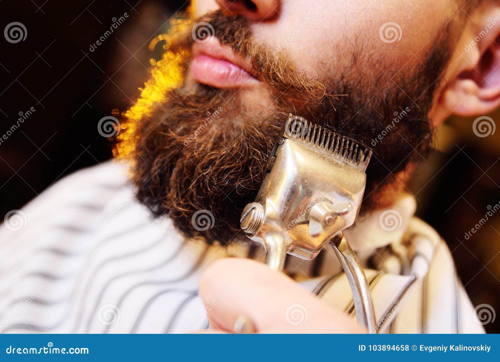 Shaving your beard in barbershop