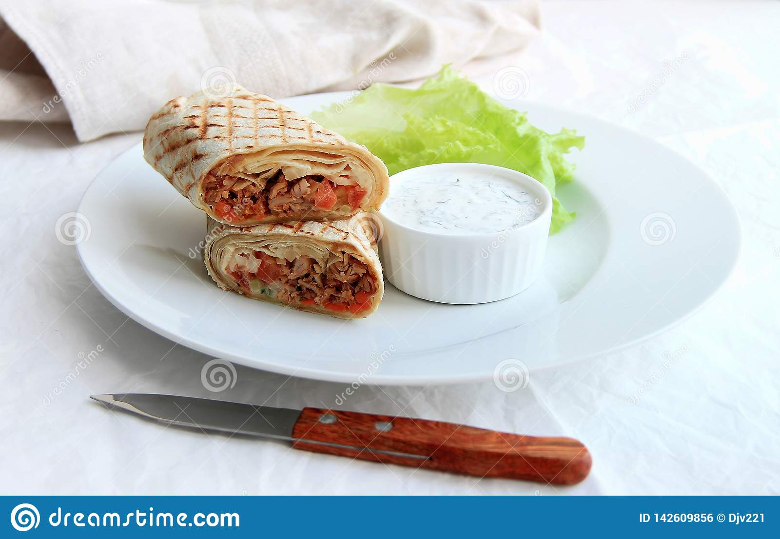 shawarma with chicken, vegetables and salad on a plate