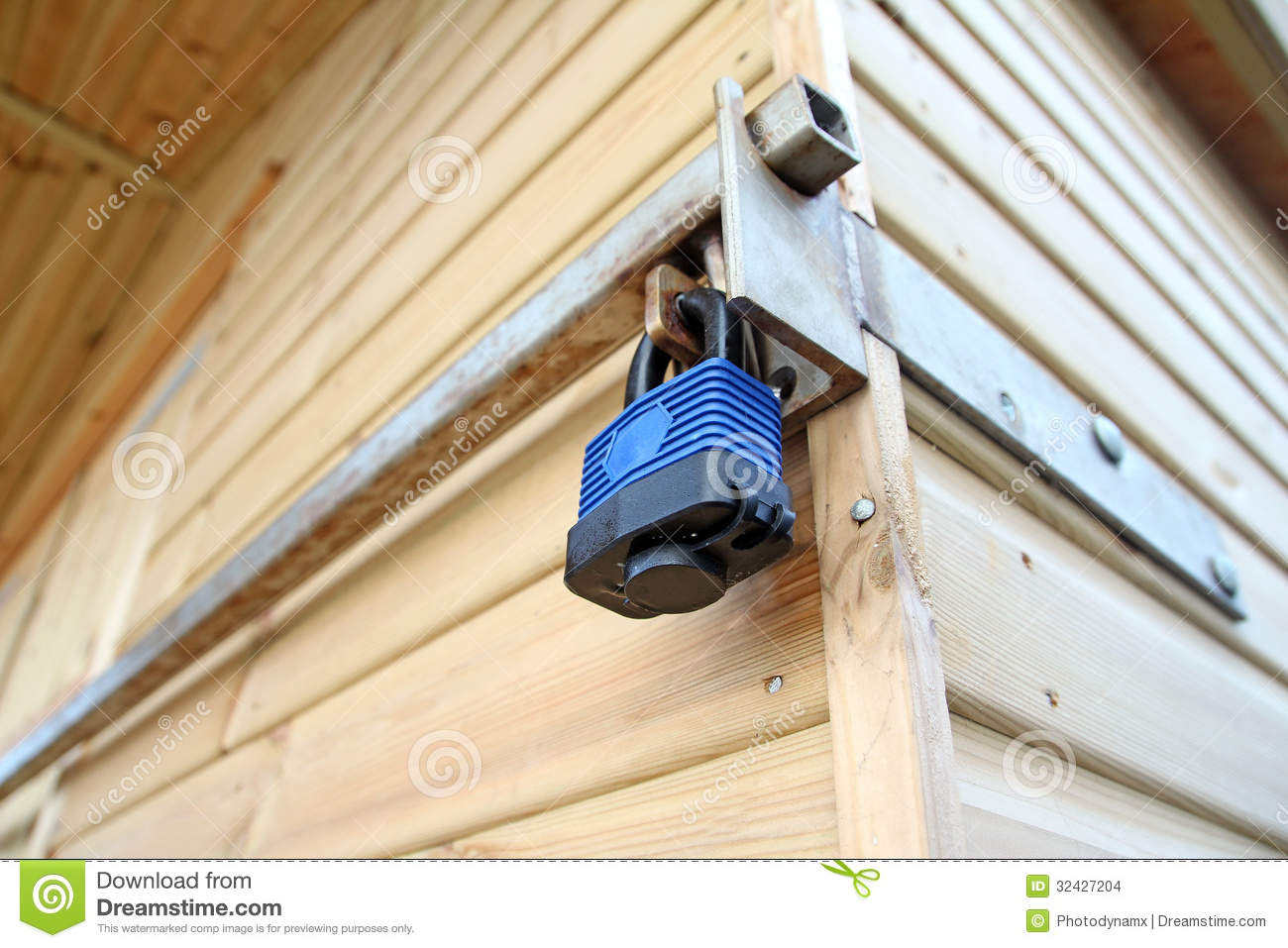 Photo of a security lock and bar attached to a beach hut.