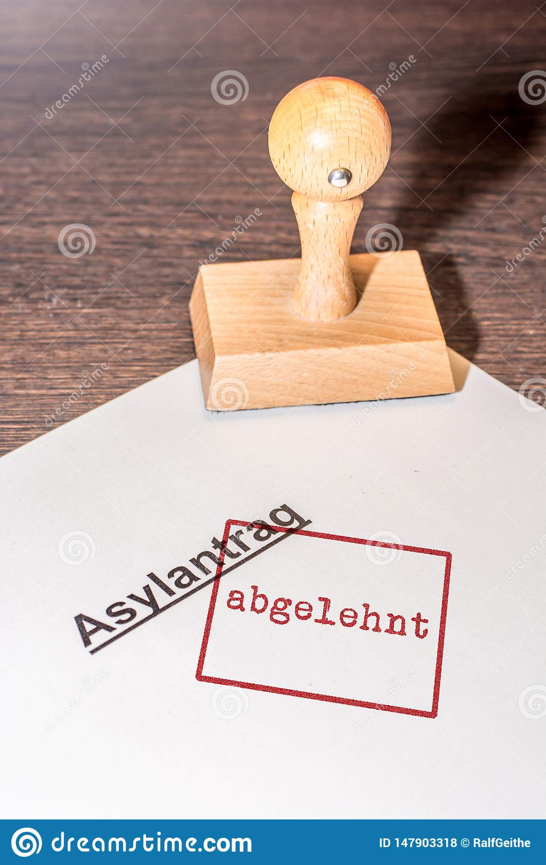 The document of an asylum application stamped `rejected` in German