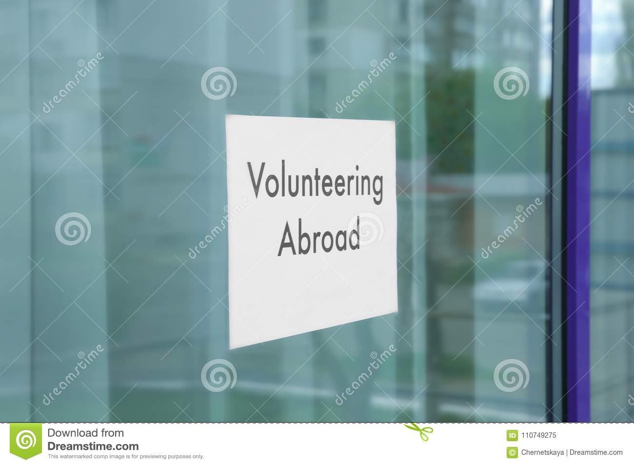sheet of paper with text volunteering abroad n window glass stock