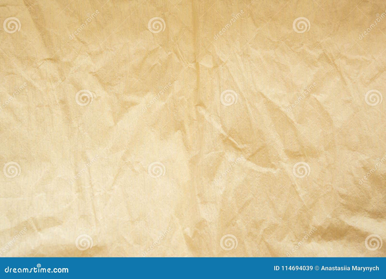 Sheet of worn beige paper as background