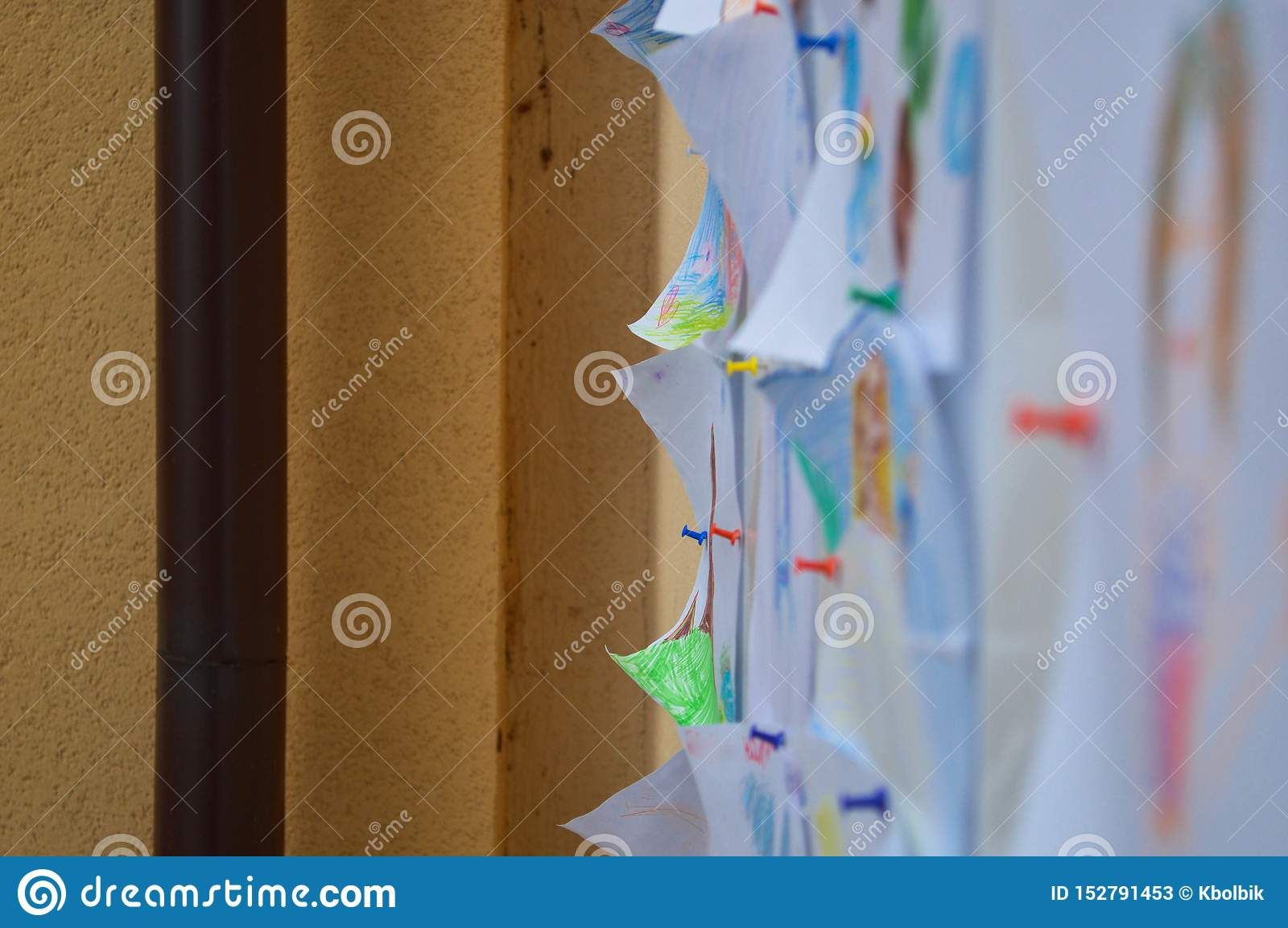 Sheets of paper, notes, drawings, documents pinned to a blackboard, a wall for a reminder, submission of announcements, scheduling