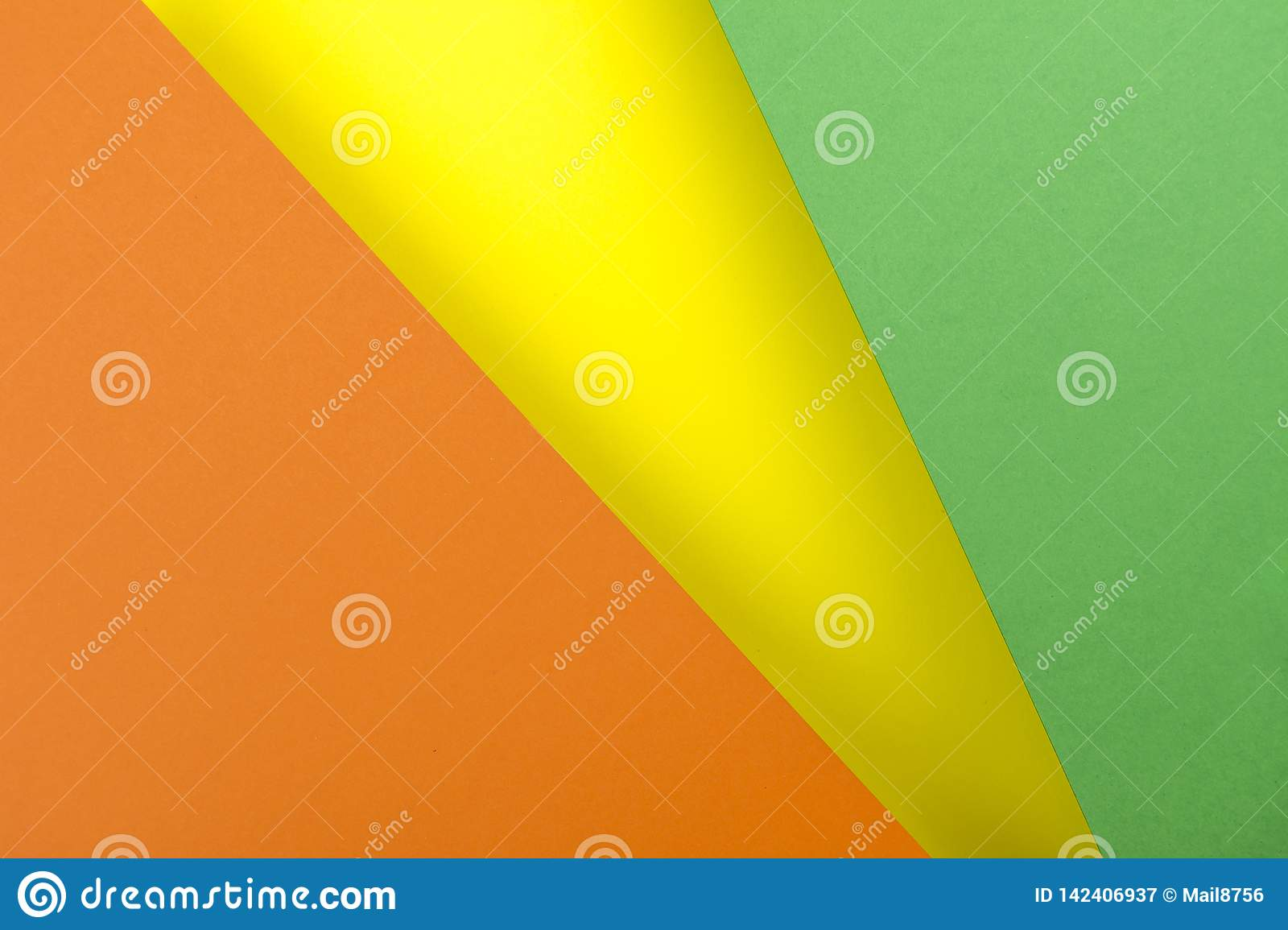 Sheets of paper yellow, green, orange colors lined with shade