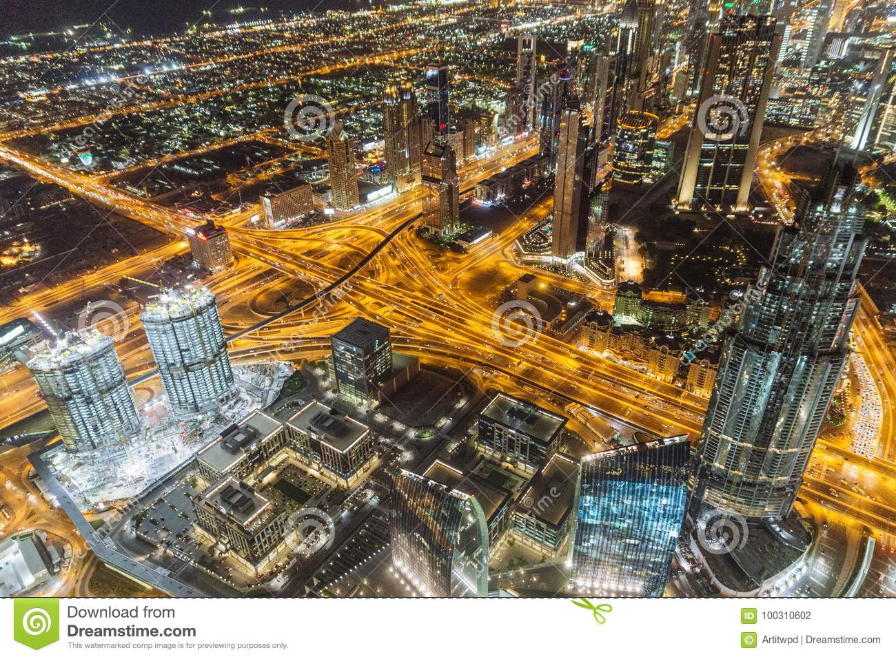 Sheikh Zayed road in the night with yellow light and buildings that view from Burj Khalifa observation floor in Dubai