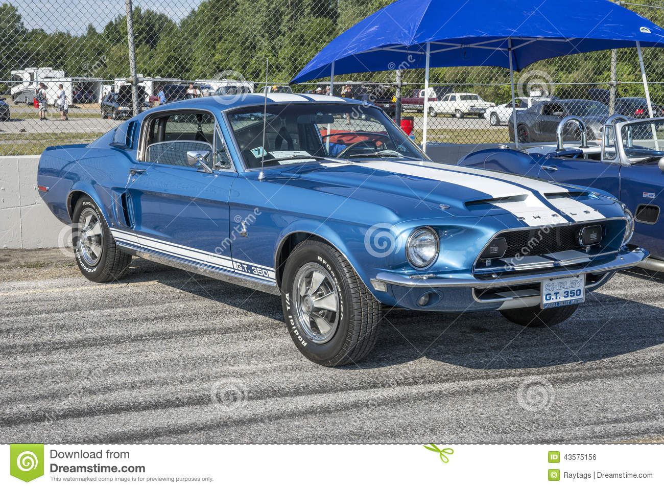 Sanair august 9 2014 front side view of blue 1968 mustang shelby gt with white lemans stripes at 19e super ford show