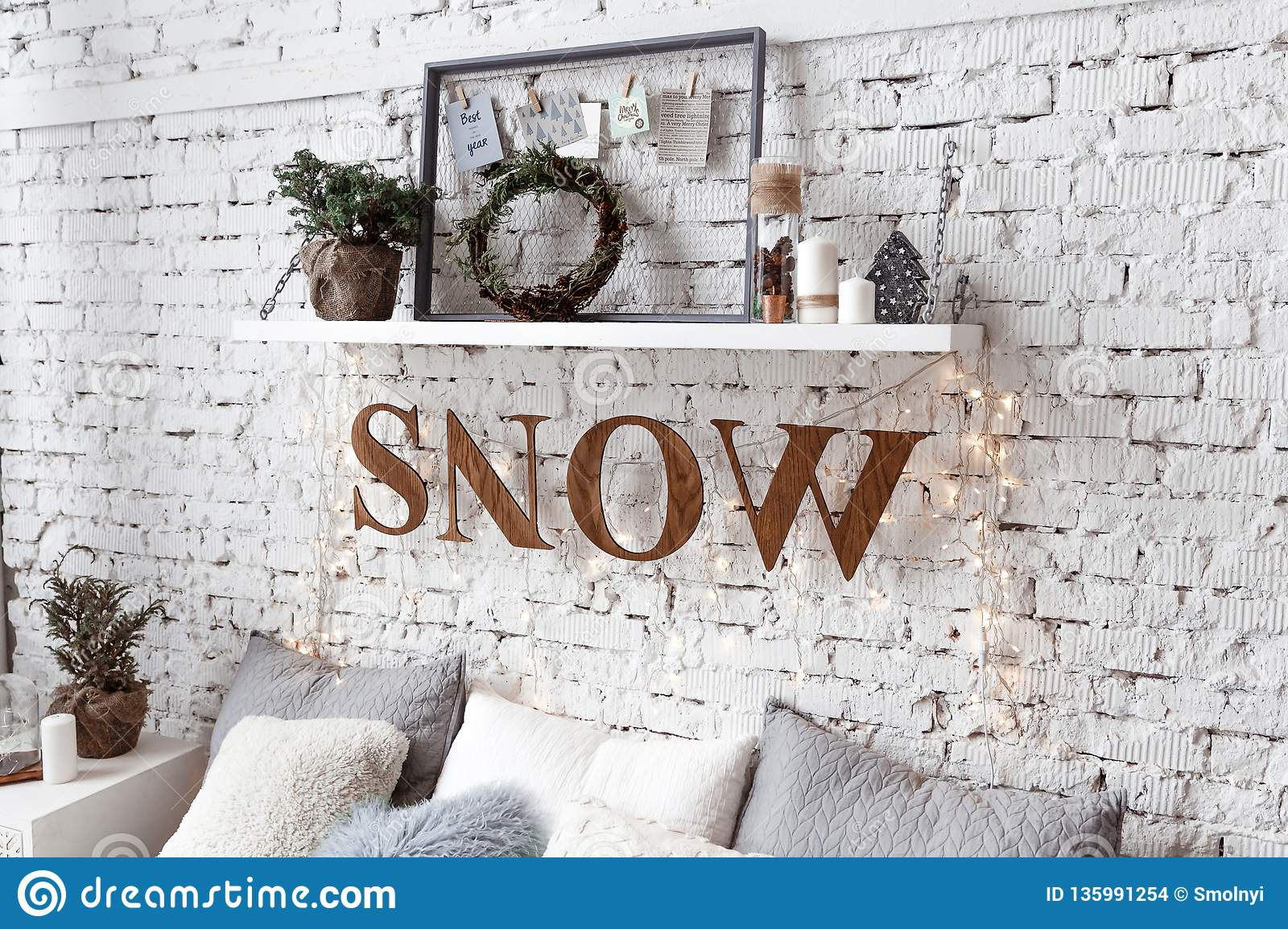A Shelf Above The Bed On The Background Of A Brick Wall Loft Decorated With Retro Garland Stock Photo Image Of Frame Garland 135991254