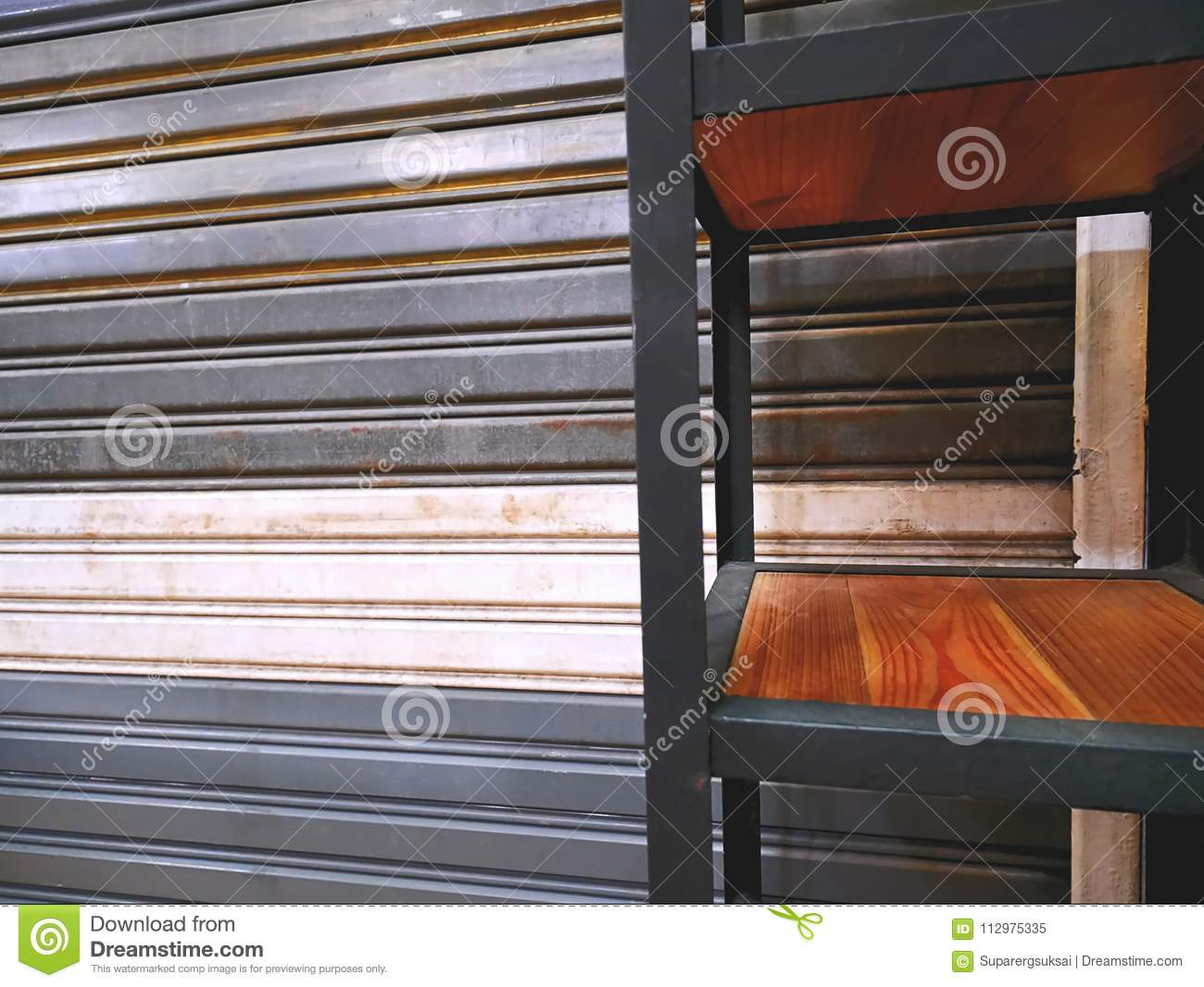 Shelf In Front Of Metal Foldable Corrugated Door