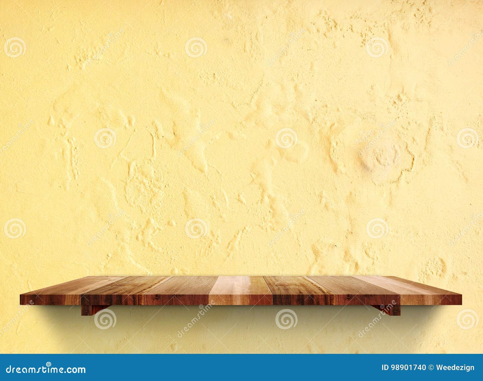 Shelfs En Bois Vides Sur Le Mur En Beton Jaune Grunge En Pastel