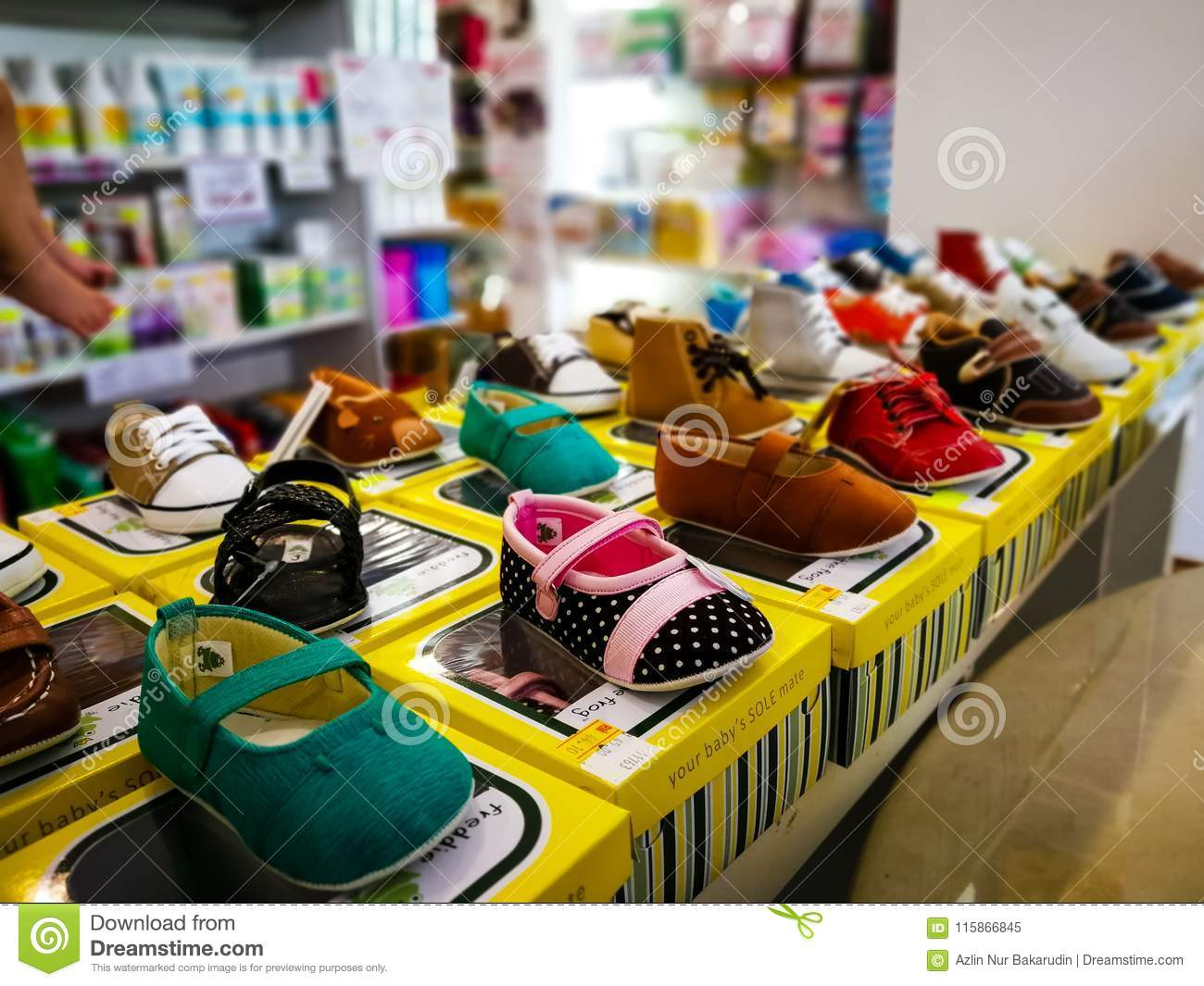 Shelves With Assortment Of Baby Shoes