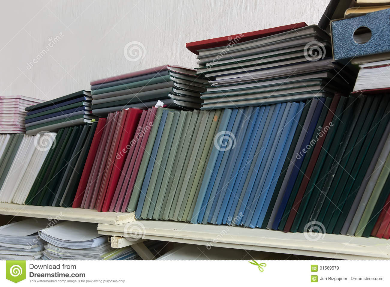 Shelves with folders with documentation