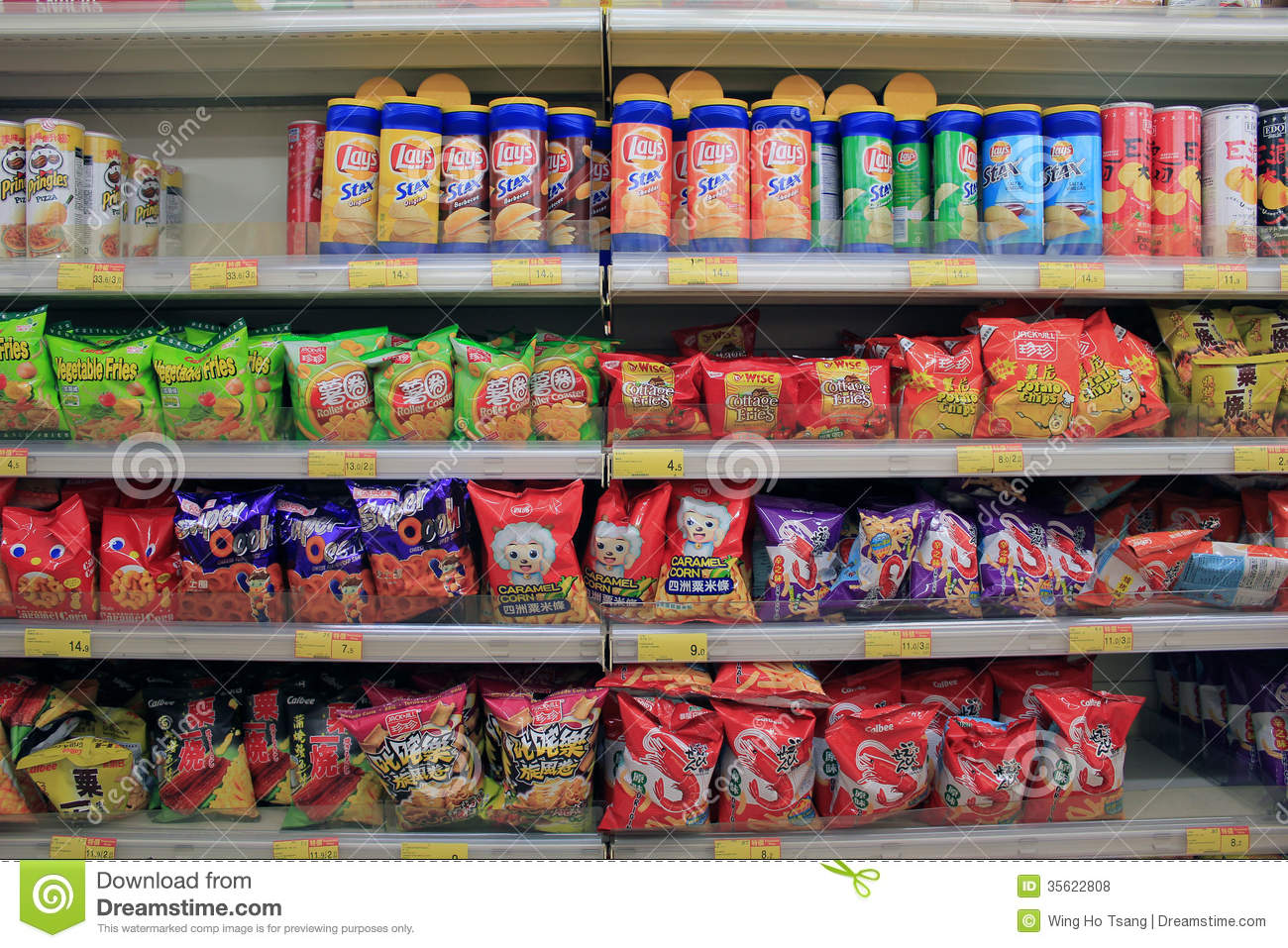 Shelves With Snack In Supermarket Editorial Stock Photo