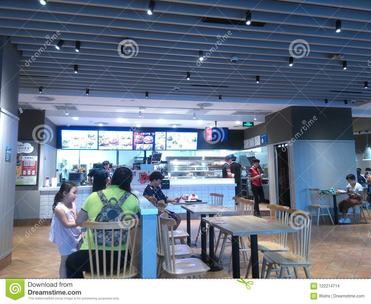 Shenzhen, China: the indoor scenery of KFC restaurant, people enjoy delicious food.