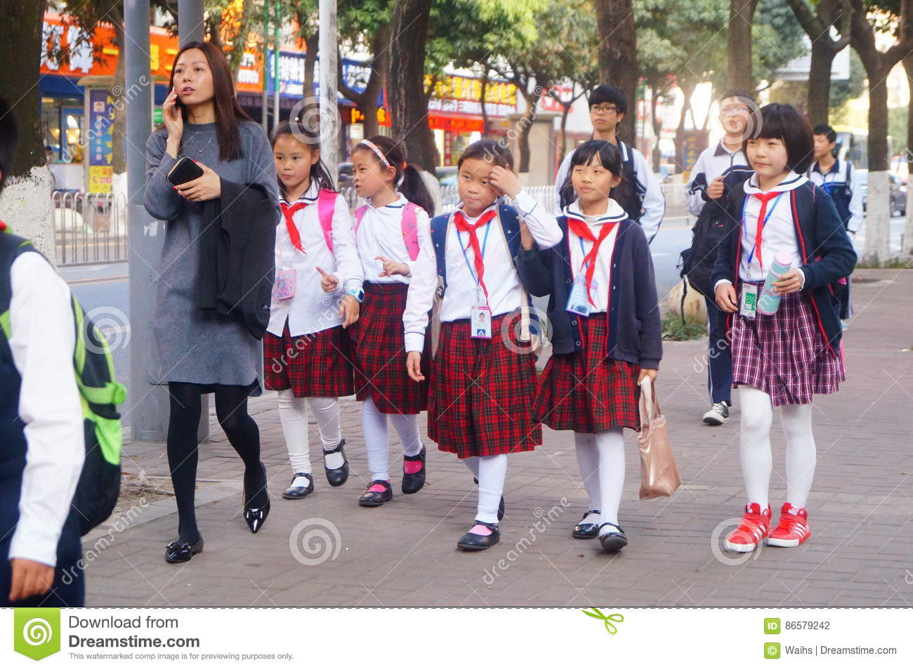 Shenzhen, China: students walk home after school