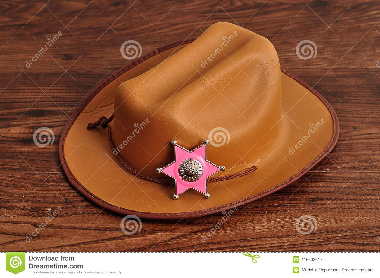 c54a71d07dae4 A Sheriff Badge With A Brown Cowboy Hat Stock Image - Image of ...