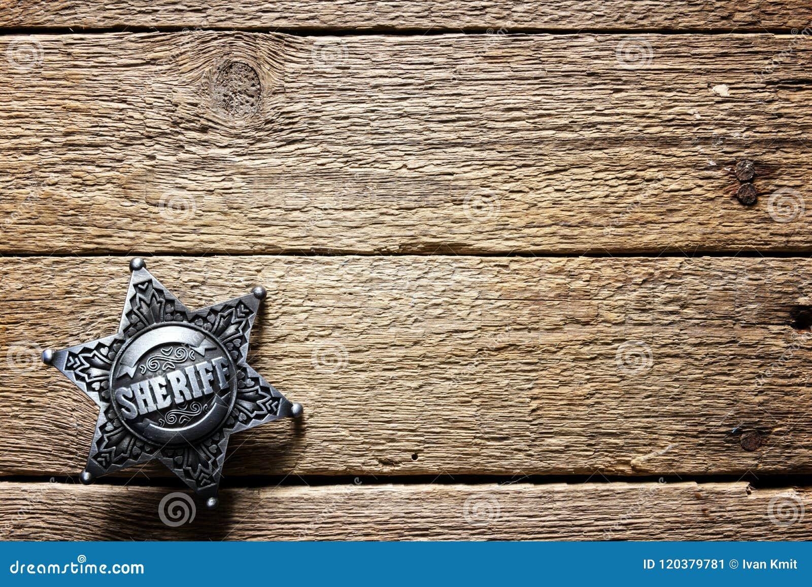 Sheriffstjärna på trätabellen