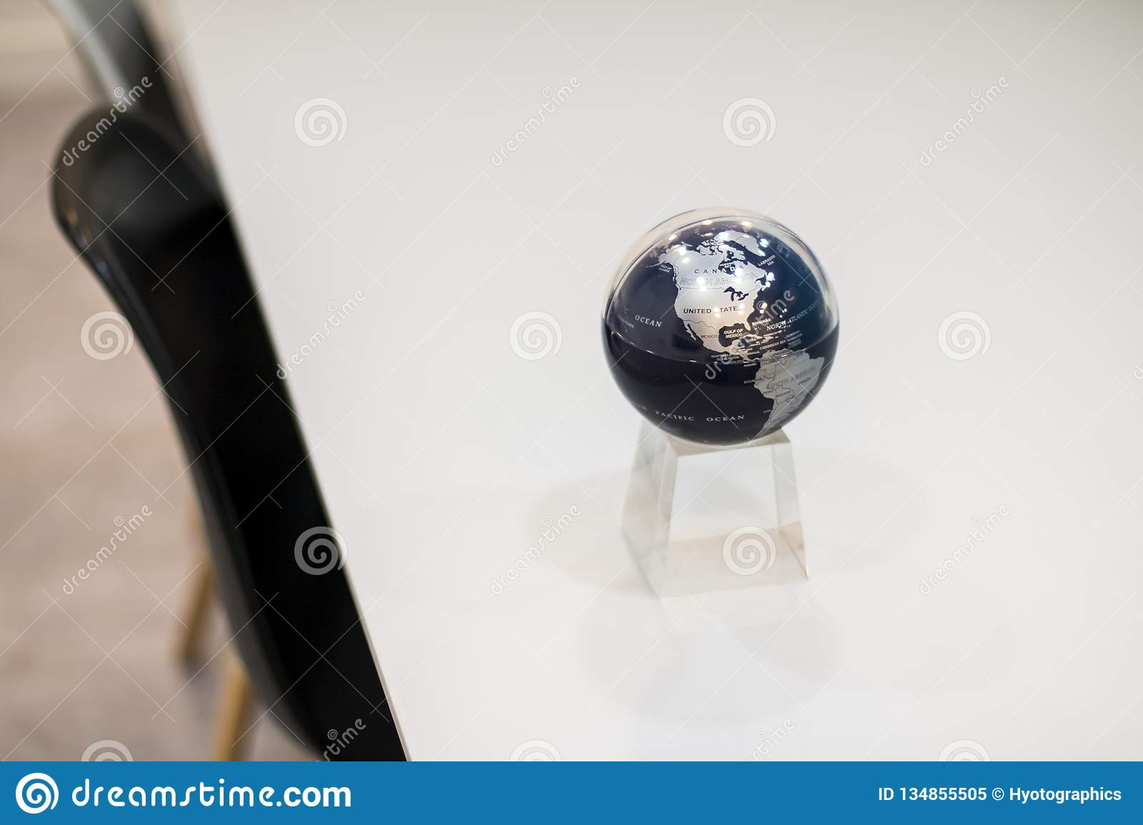 A shining Blue Globe on the table