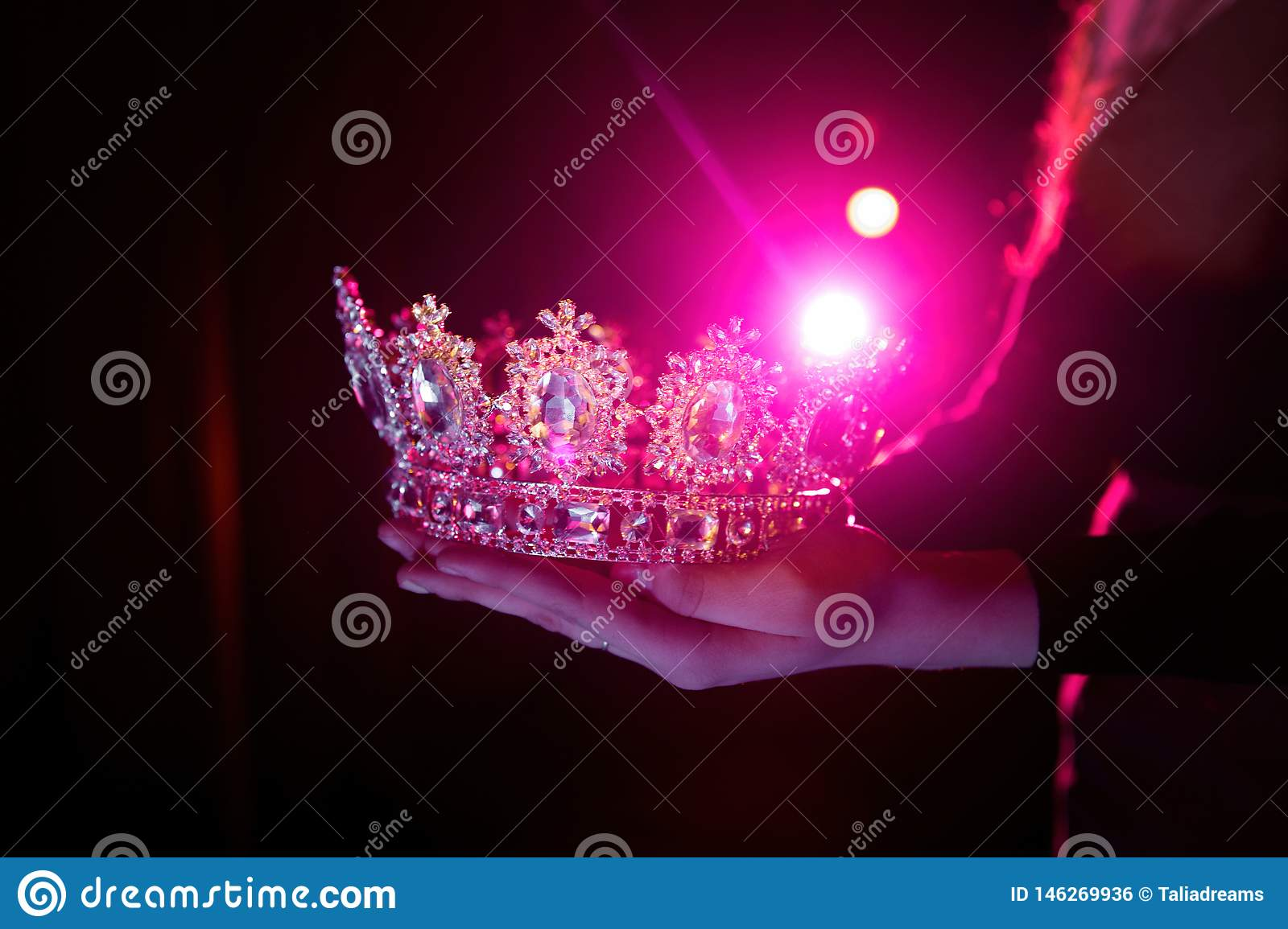 Shining crown in the hands